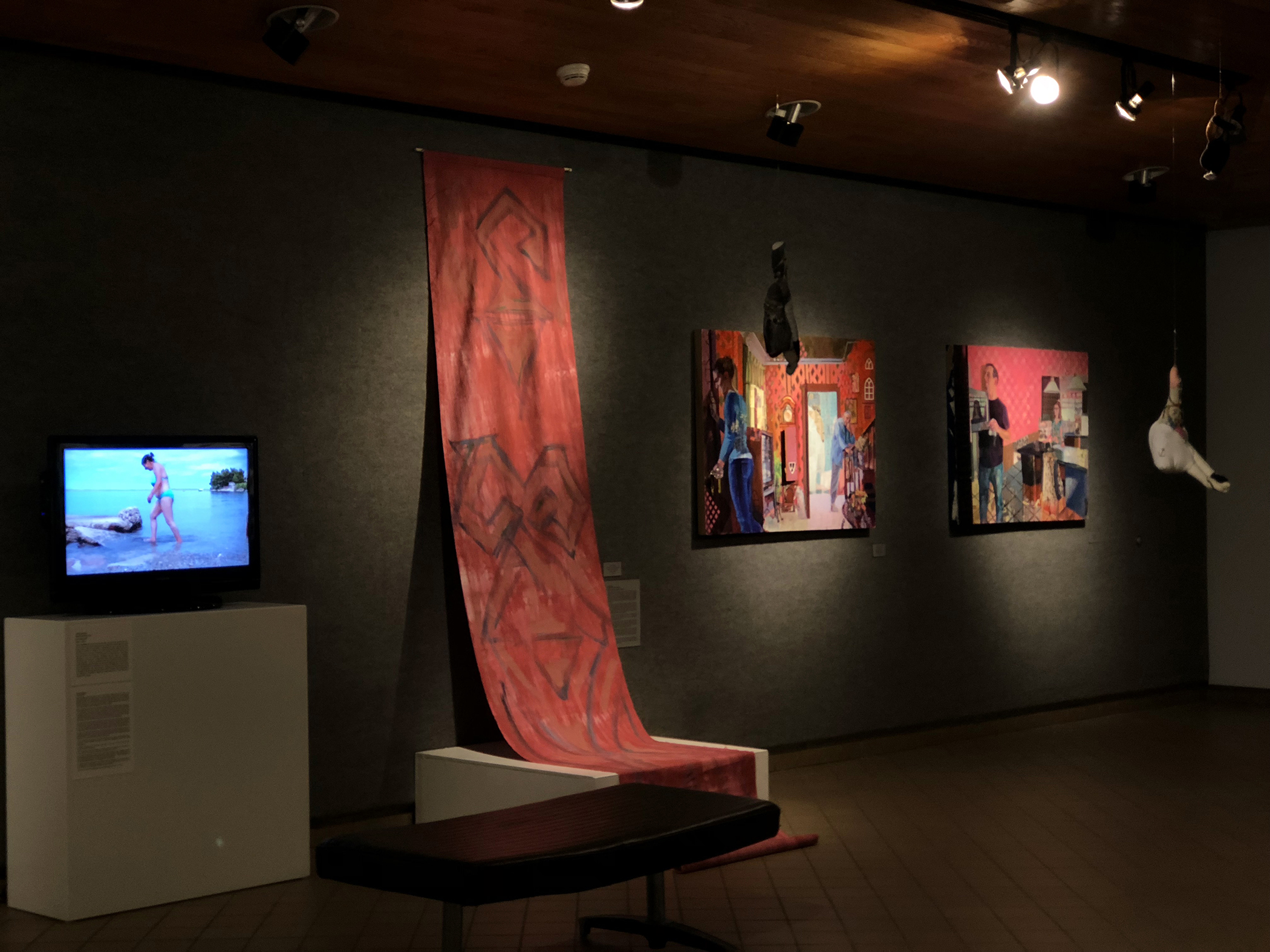 installation shot of works by (l to r): Selma Selman, 'Salt Water at 47'; Emira Hajdar, 'Vertikalni duh (Vertical spirit)'; Danielle Mužina, 'Fly the Coop' and 'Fatherland'; and work by Maja Ružnić hanging in foreground, 'Dream Phantom' (left) and 'Leaning Woman' (right) – from 'Proof of Existence' at WKU