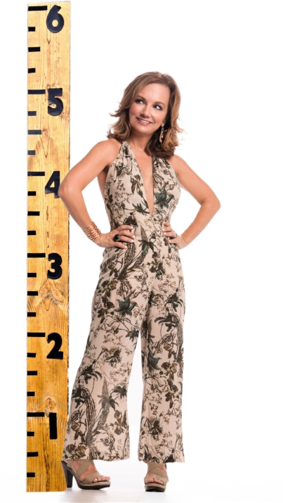 """At 5'1"""" (if you round up, and I hope you will), I have my own fit challenges, so can easily relate to the myriad of style issues my clients report facing. I find that monochromatic dressing lengthens my petite frame, so I decided to try pattern from head to toe with this Free People jumpsuit. Stella & Dot cuff and earrings; Cordani sandals."""