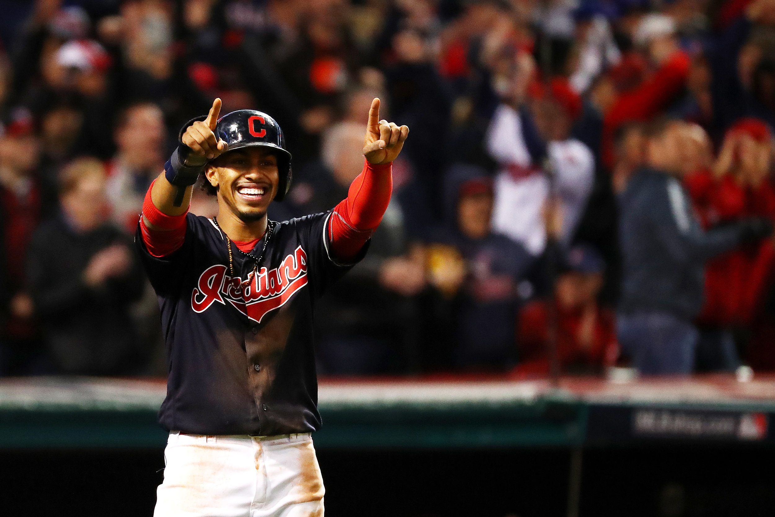 CLEVELAND, OH - OCTOBER 25: Francisco Lindor #12 of the Cleveland Indians celebrates after scoring a run during the first inning against the Chicago Cubs in Game One of the 2016 World Series at Progressive Field on October 25, 2016 in Cleveland, Ohio. (Photo by Tim Bradbury/Getty Images)