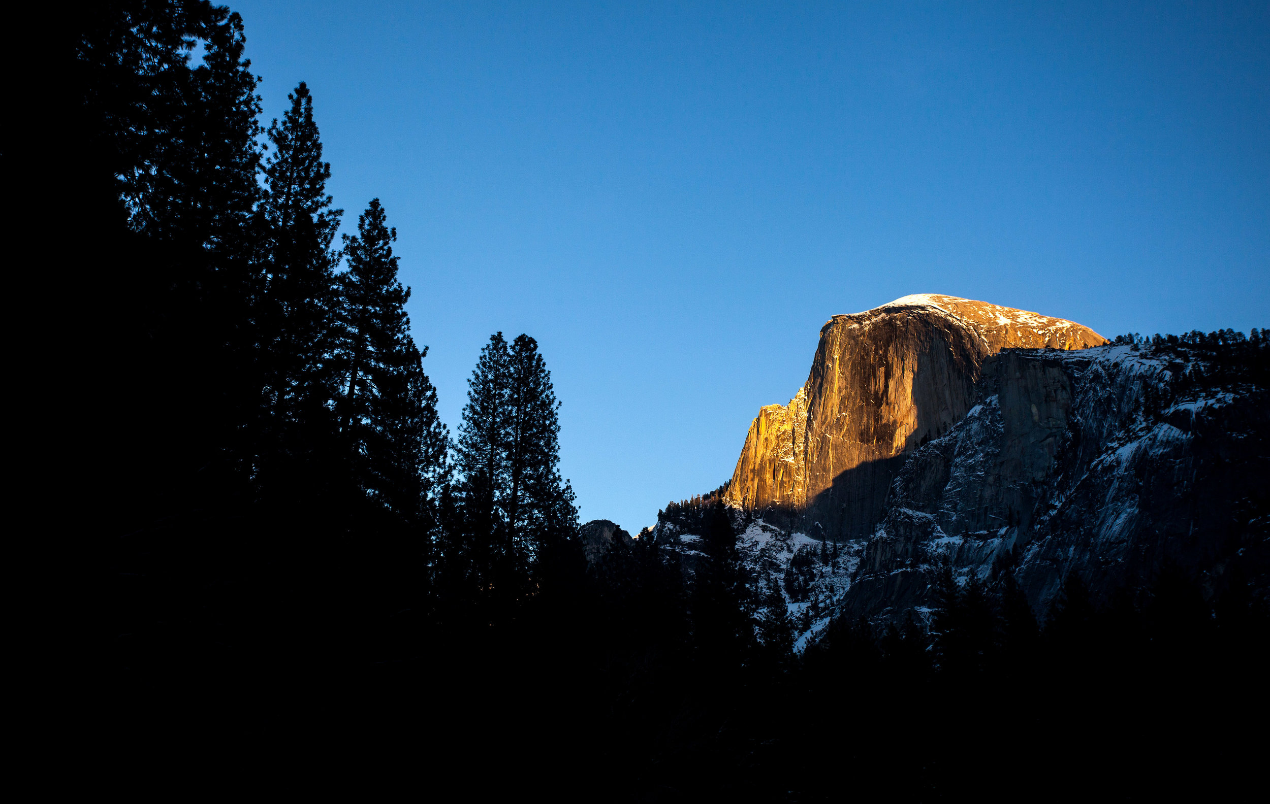 YOSEMITE, CA - DECEMBER 28: Half Dome is seen during sunset at the eastern end of Yosemite Valley on December 28, 2016 in Yosemite National Park, California. (Photo by Tim Bradbury/Copyright 2017)