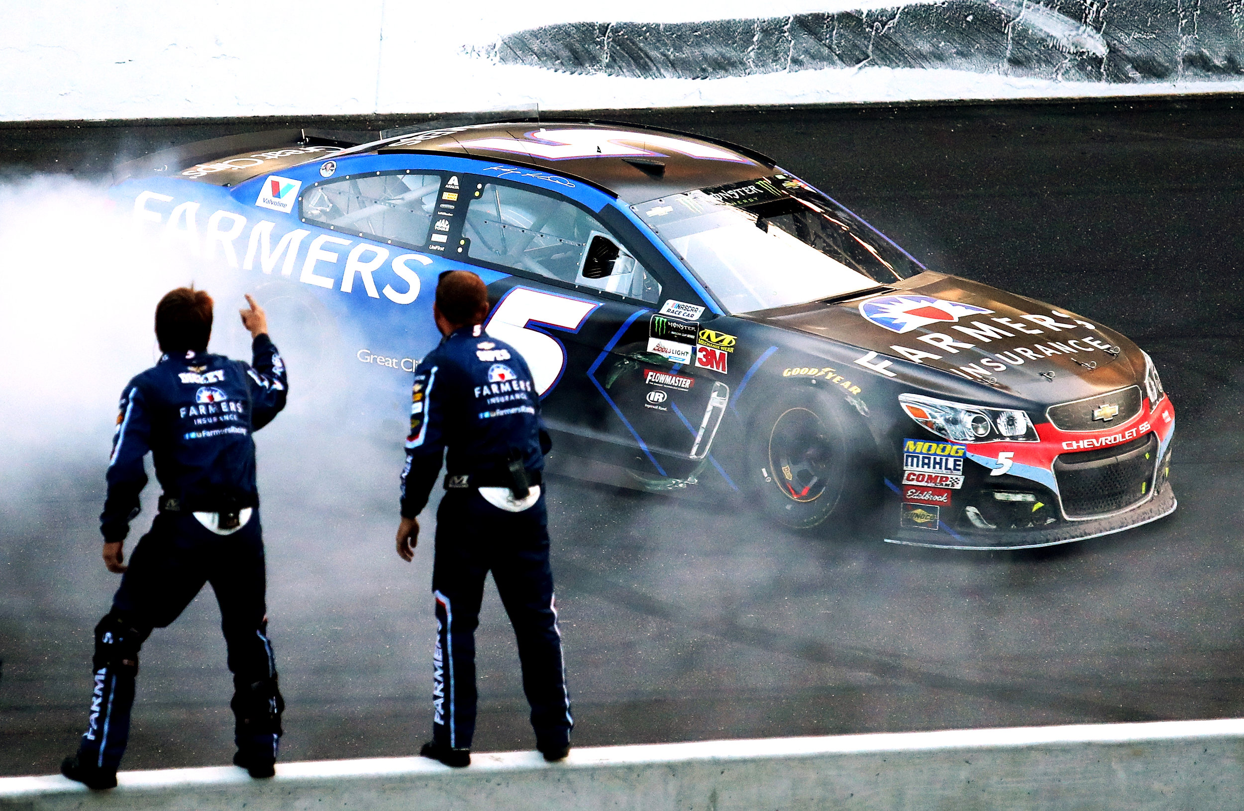 INDIANAPOLIS, IN - JULY 23: Kasey Kahne, driver of the #5 Farmers Insurance Chevrolet, celebrates with a burnout after winning the Monster Energy NASCAR Cup Series Brickyard 400 at Indianapolis Motorspeedway on July 23, 2017 in Indianapolis, Indiana. (Photo by Tim Bradbury/Getty Images)