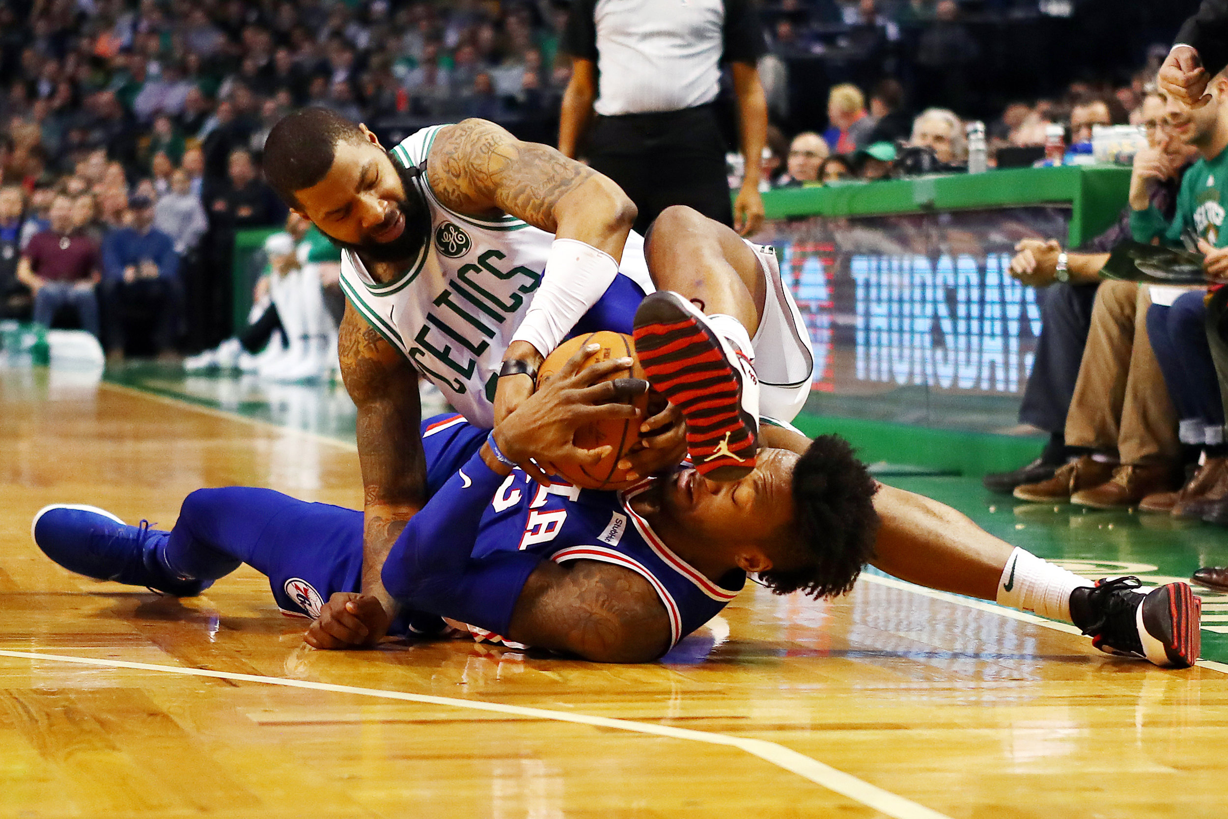 BOSTON, MA - JANUARY 18: Robert Covington #33 of the Philadelphia 76ers and Marcus Morris #13 of the Boston Celtics battle for a loose ball during the first half of their game at TD Garden on January 18, 2018 in Boston, Massachusetts. (Photo by Tim Bradbury/Getty Images)