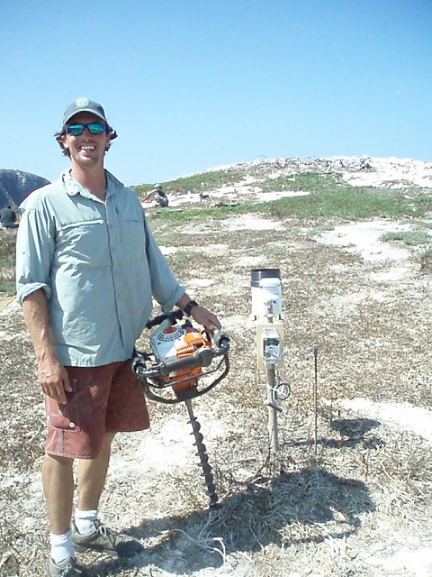 David Mazurkiewicz, former GS Employee, augering holes for native Santa Cruz Island plants on Scorpion Rock to provide nesting ground cover for recovering seabird species. David now works for the National Park Service.