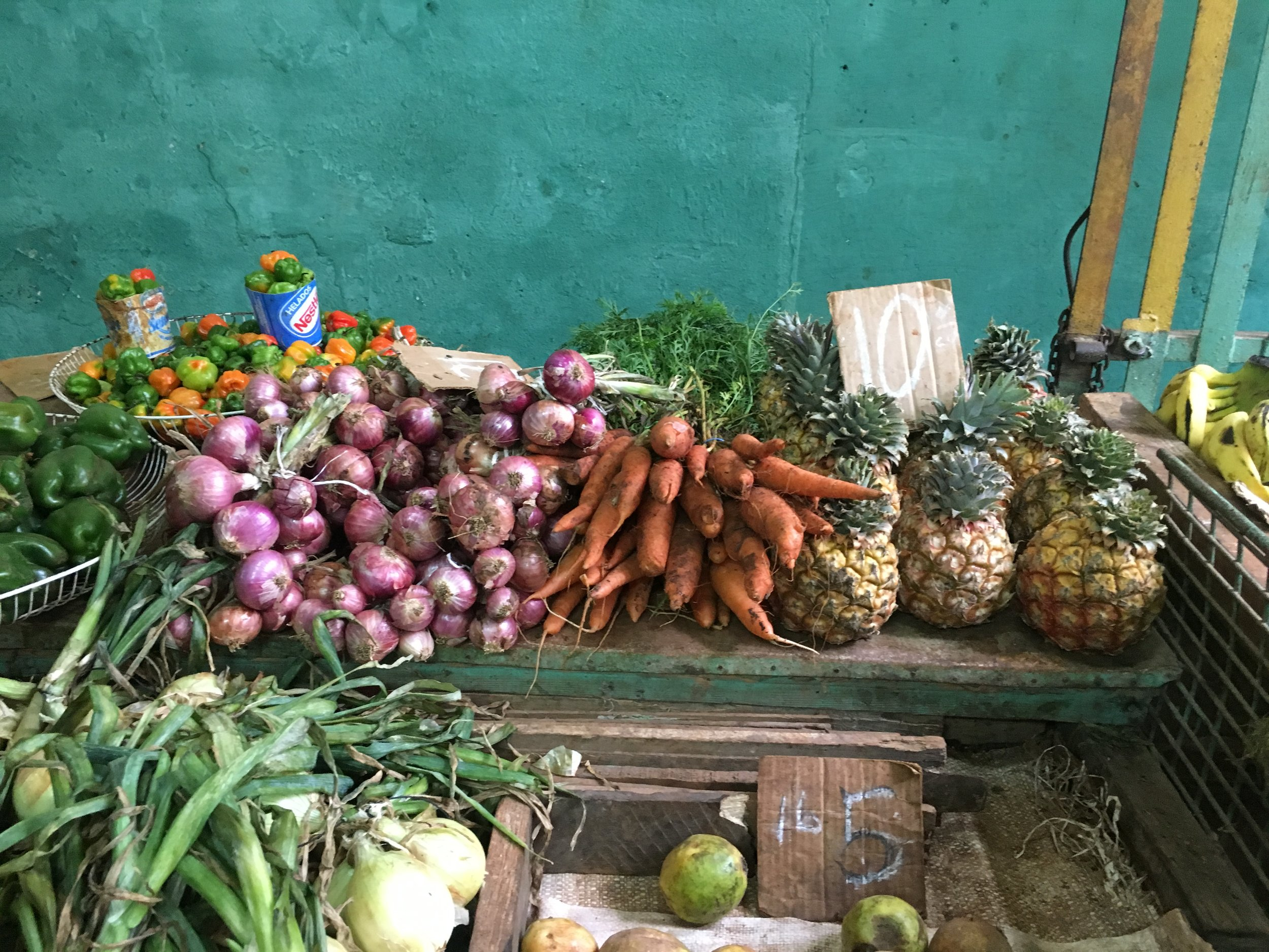 A typical veggie stand in Havana's residential neighborhoods. The carts are brought out in the morning loaded up with produce that comes in from farms located on the outskirts of the city.