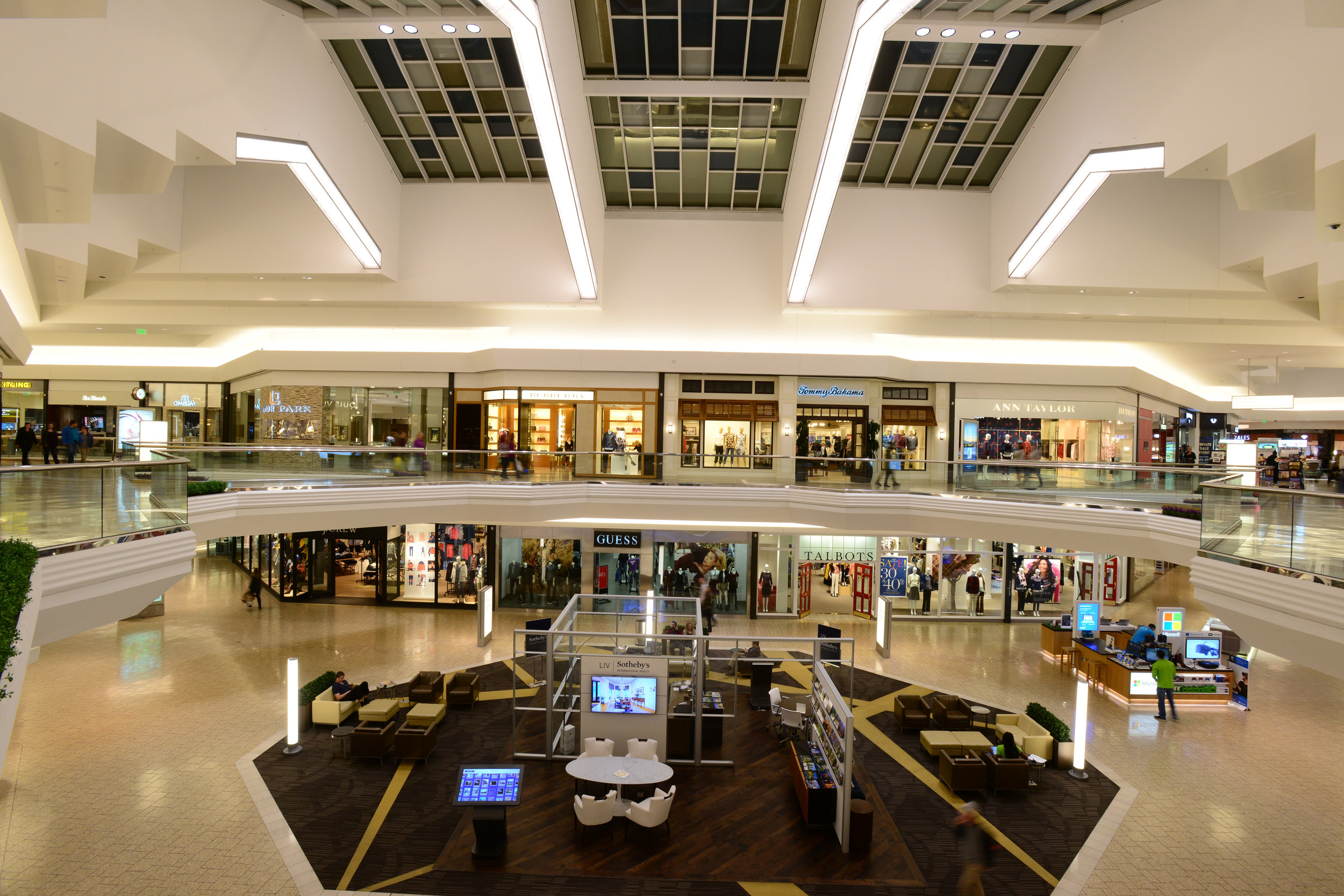 The renovated interior of the mall includes a new ridge skylight, escalators & seating areas.