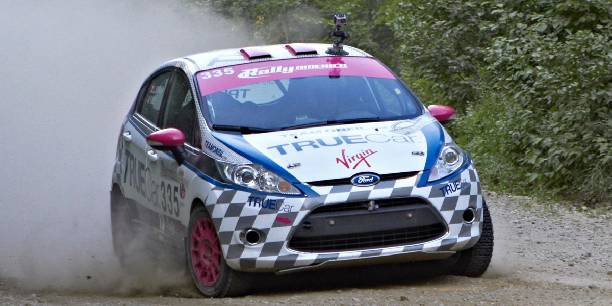 Verena in action at New England Forest Rally in the TrueCar / Virgin Fiesta #335