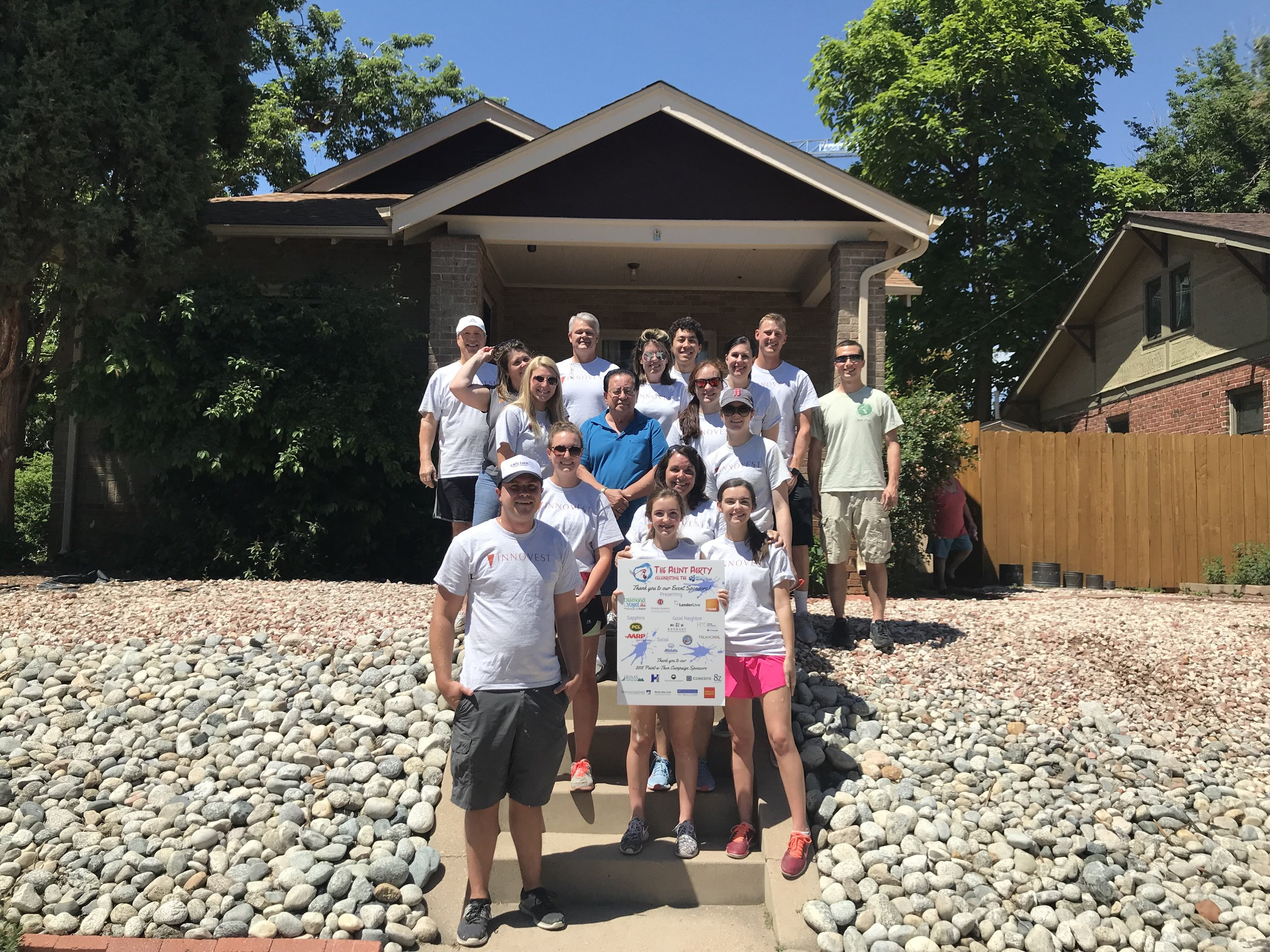 Innovest employees volunteered to paint a senior's home for Brother's Redevelopment.