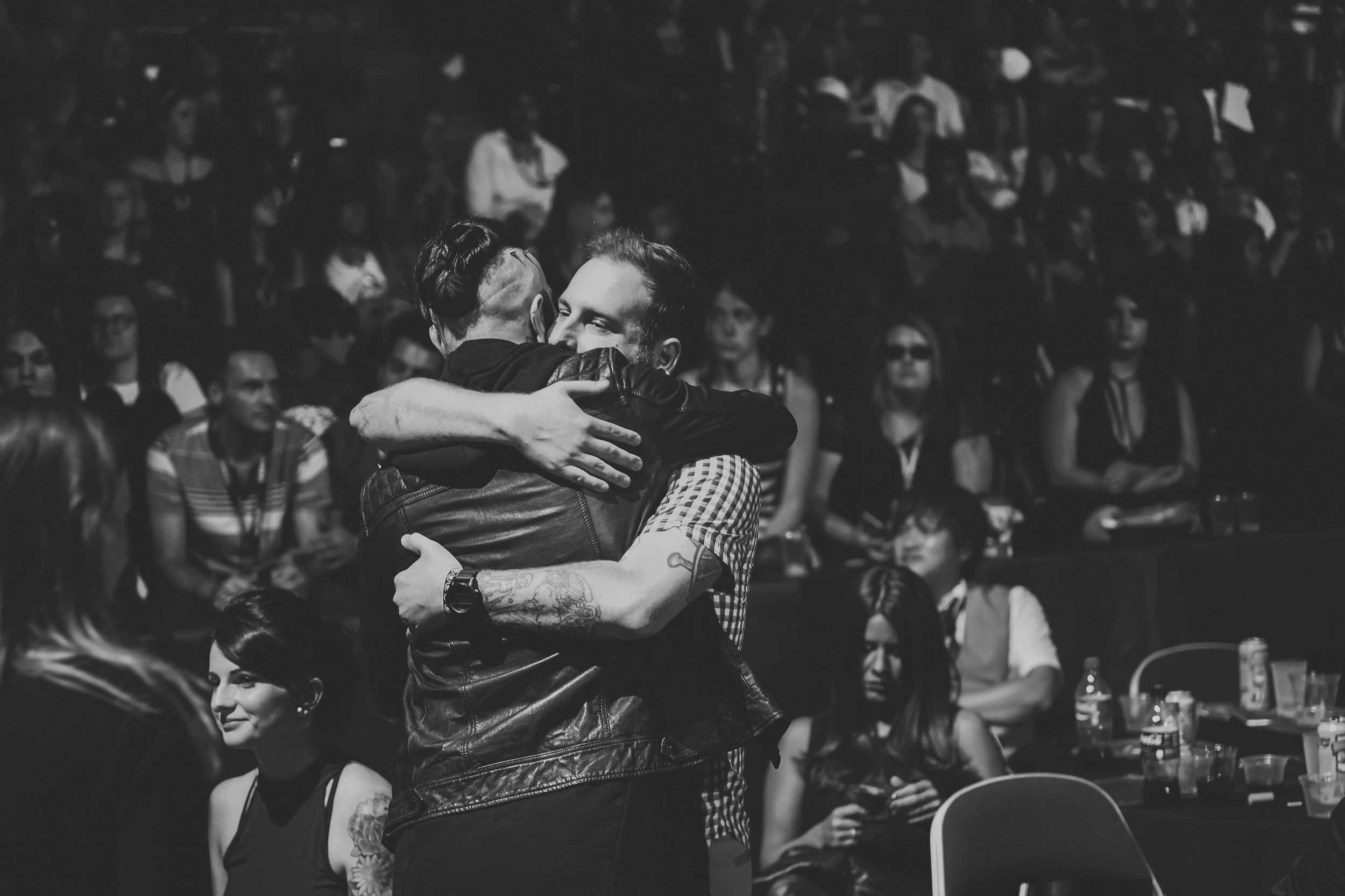 I wanted to end the APMAS segment with this photo. This is Jonathan Vigil of The Ghost Inside and Chris Cerulli of Motionless In White. If you don't already know, last year The Ghost Inside were involved in a fatal bus accident that left all of them in the hospital, and most unable to walk. This was their first public appearance since that accident, and there were a lot of emotions that night because of it. This photo is full of raw emotion, and they stayed embraced for a solid 45 seconds. This music scene is full of different types of people. Different beliefs, values, outlooks, but everyone came together in this bands time of need, and humility was shown, by everyone. This made the night so much more beautiful than it already was.