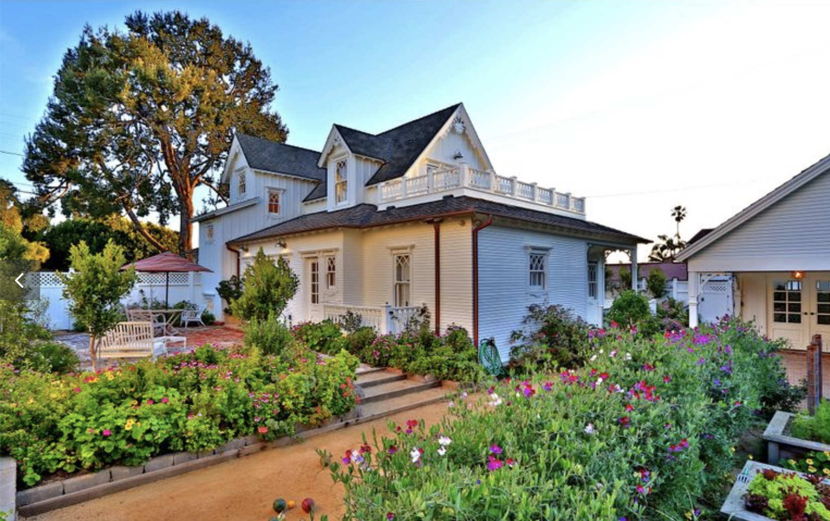 A RURAL VIBE IN MANHATTAN BEACH: - This Napa farmhouse-style home, which takes its cues from 19th-century floor plans, sits on a corner lot in the Manhattan Beach Tree Section. White bead board brings a rural tone to the interiors as does the country kitchen's butcher-block counters and farmhouse sink.