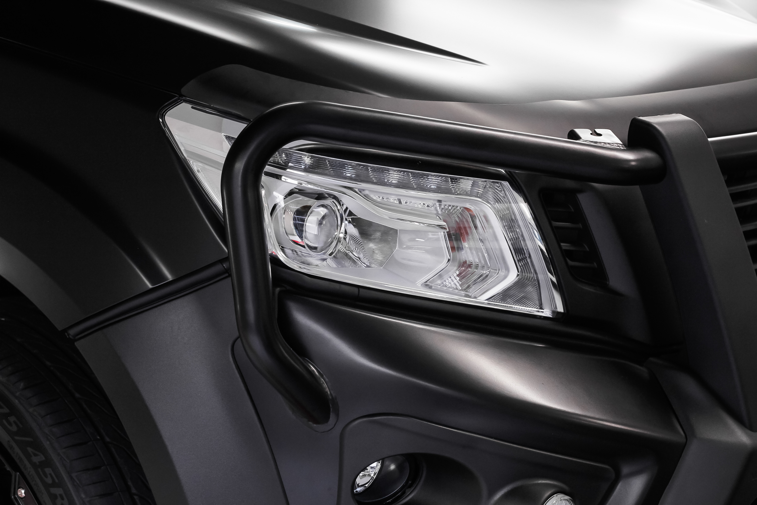Matt Black 2015 Nissan Navara front headlight