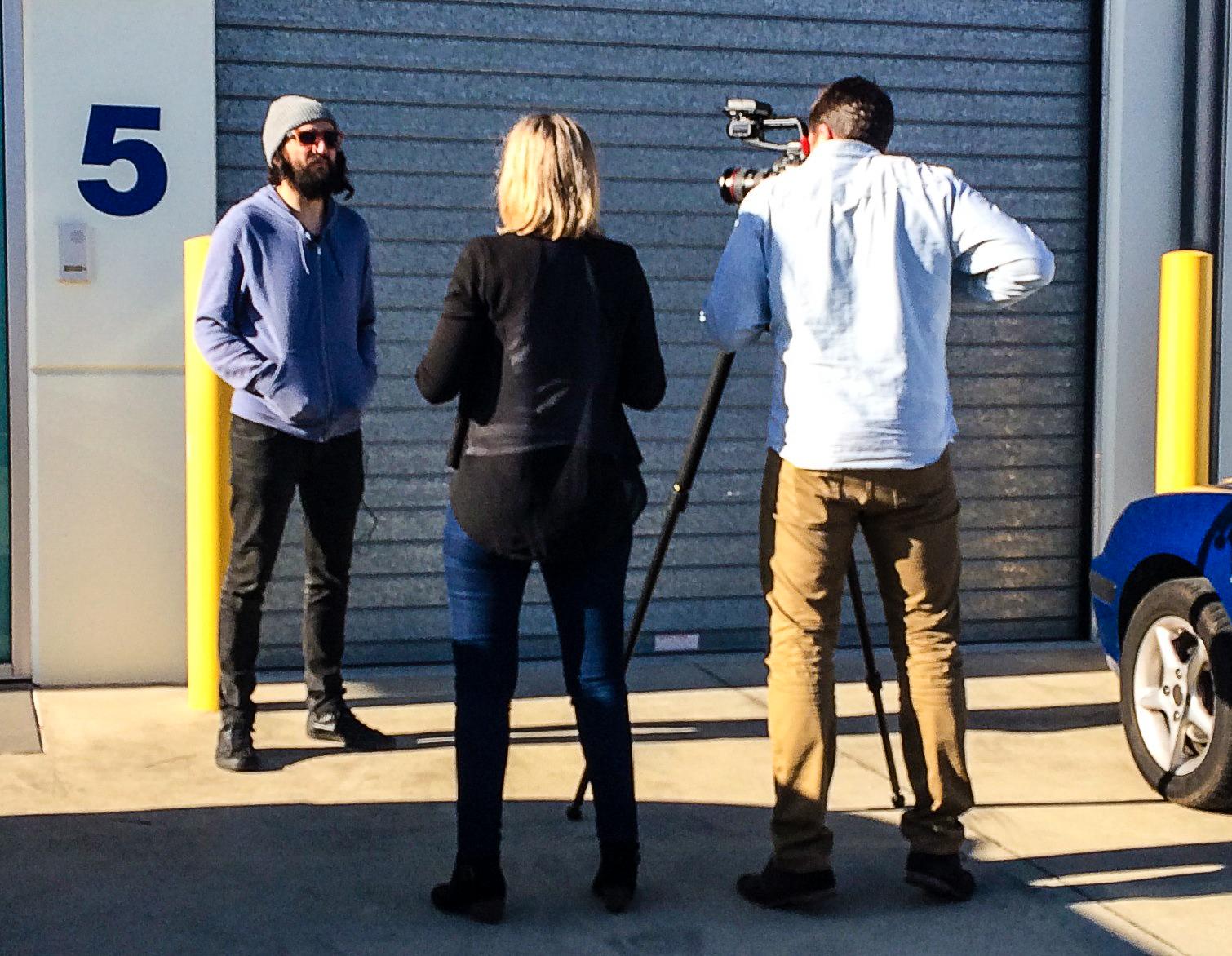 Stewart Hill being interviewed by Jasmine Gailer. Ben Trowse from Surge Media on camera.