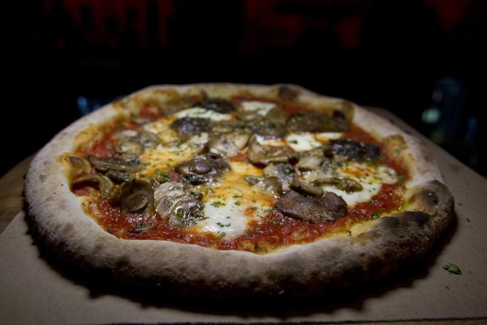 At Charcoal Guido's in Waltham, the thin-crust pizzas are perfectly charred and sized just right. Bar seating winds through the restaurant, giving patrons an up-close view as pizzas emerge from the oven, including the Portobello with Parmesan, provolone, Gorgonzola, and caramelized onion.   —Glenn Yoder