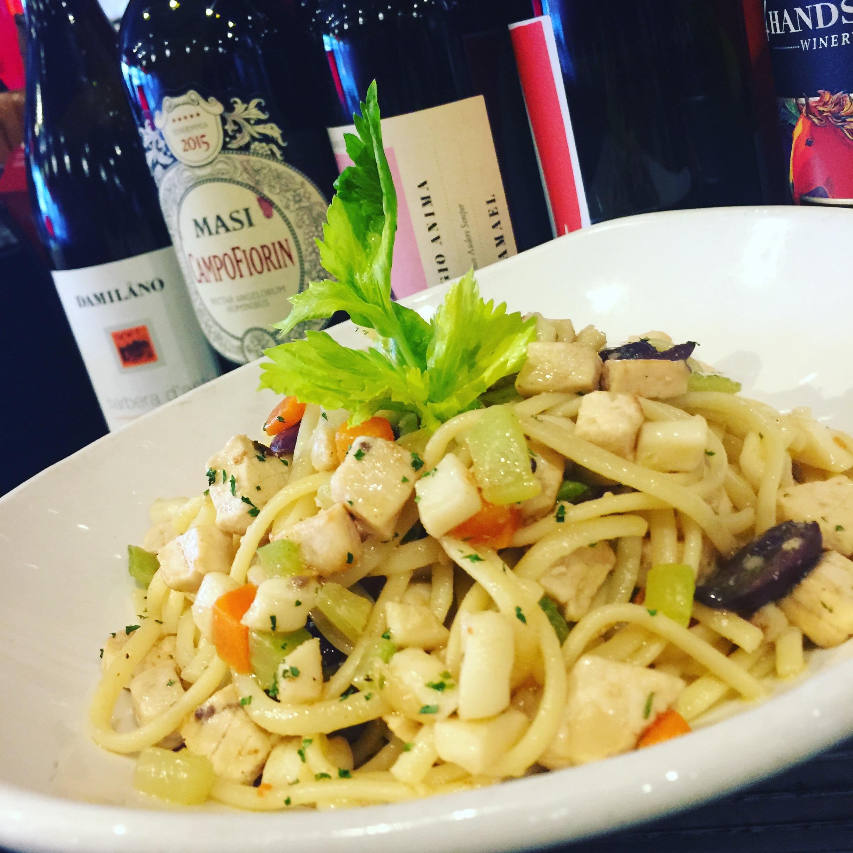 Sicilian Spaghetti - chopped swordfish, chopped calamari, onions, carrots, celery, olive, tomatoes