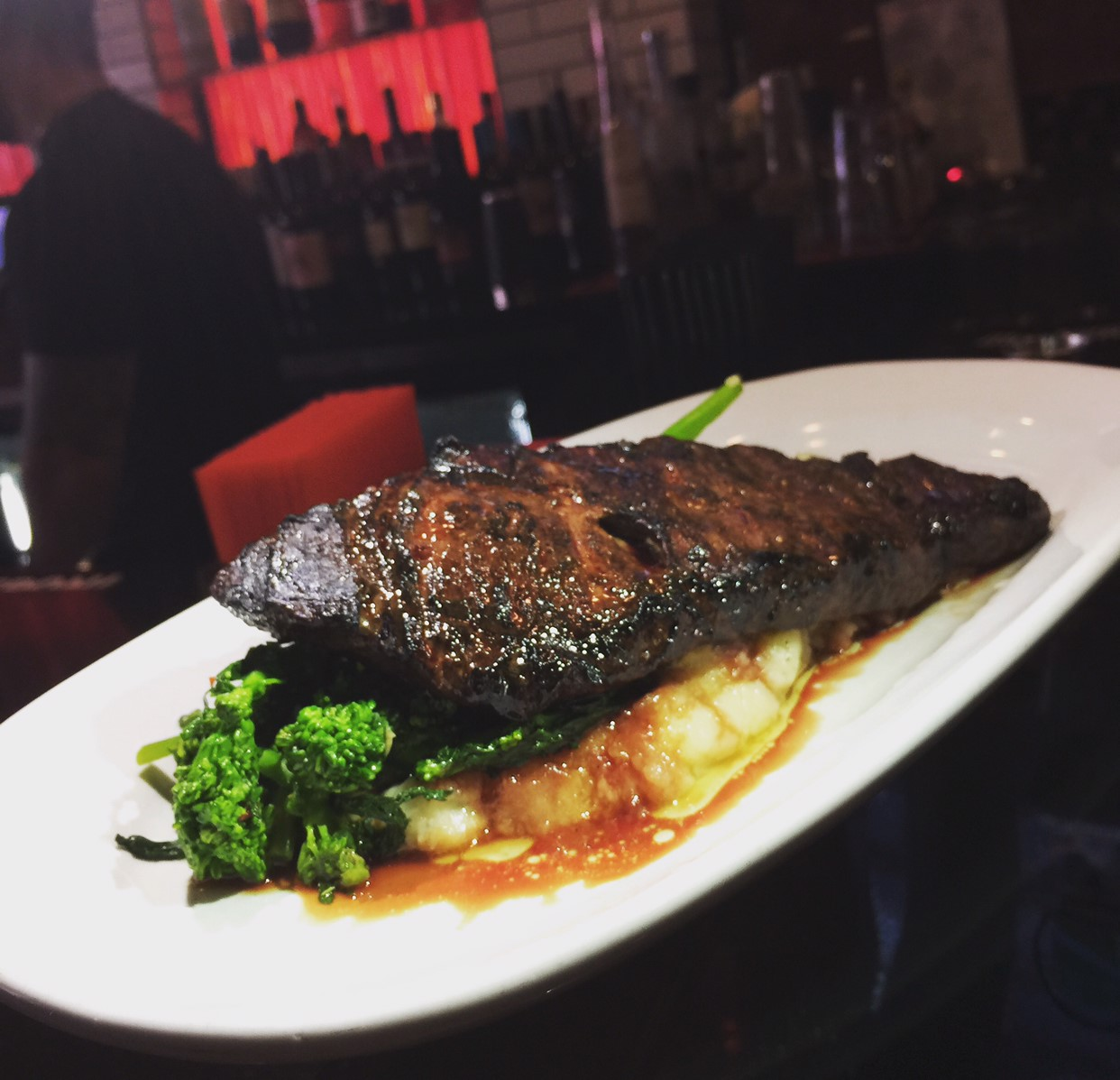 skirt steak with mashed potatoes and broccoli rabe