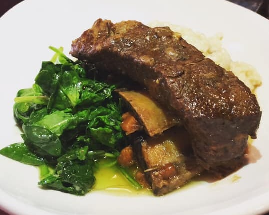 Short ribs with porcini risotto & sautéed spinach
