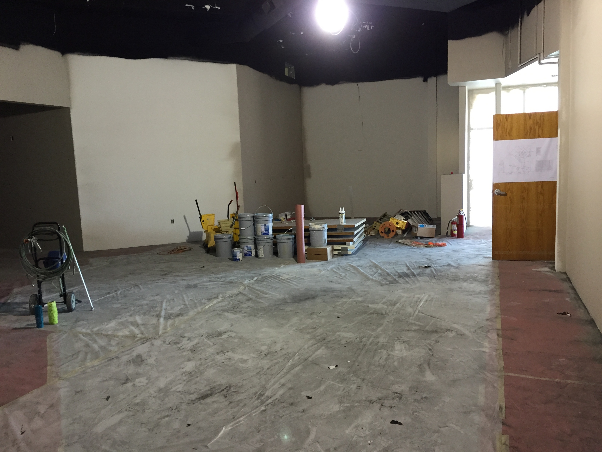A view of the atrium and cafe being prepped for a pallet wall this Saturday.