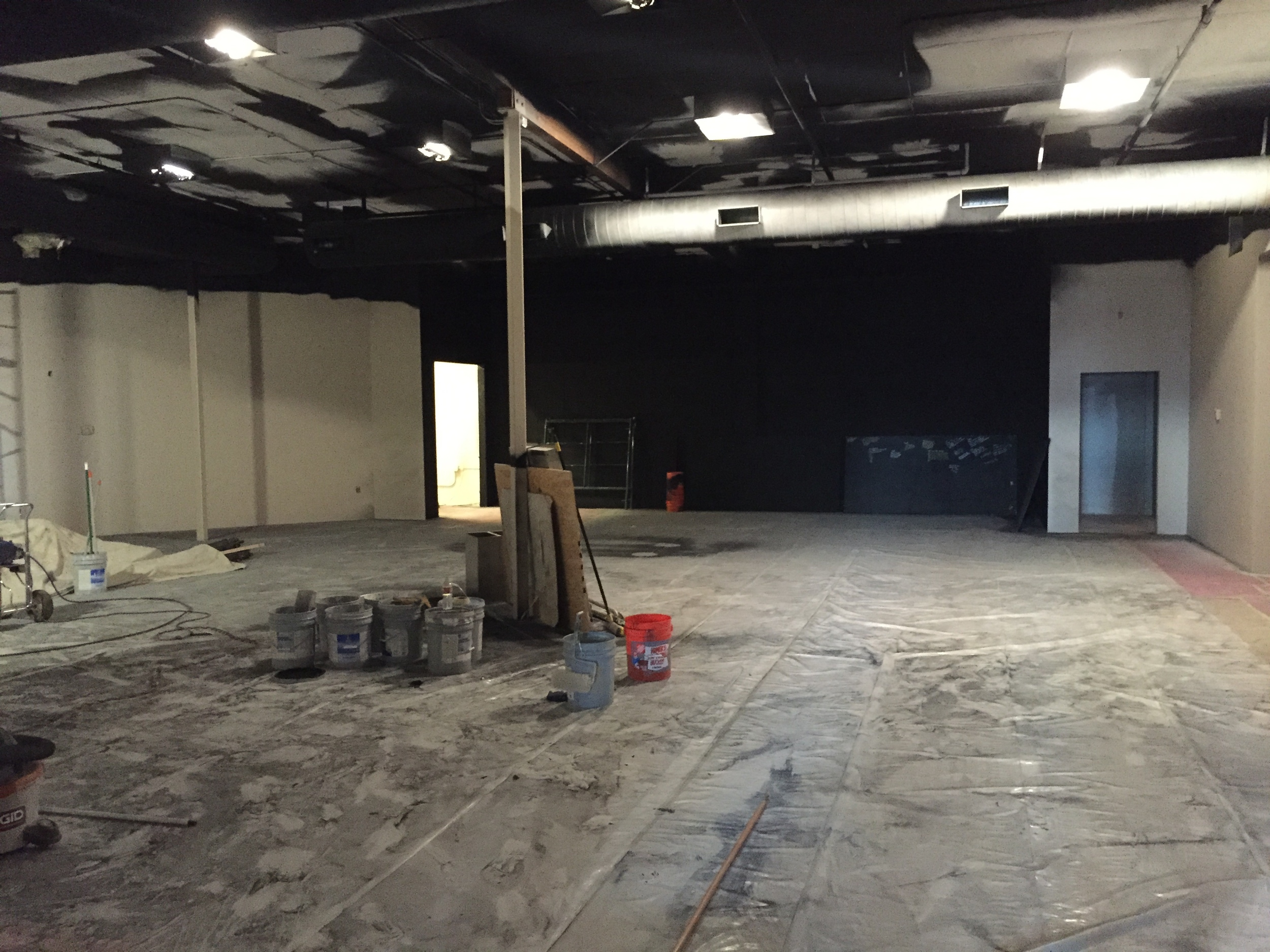 Looking toward the stage from the auditorium entry doors.