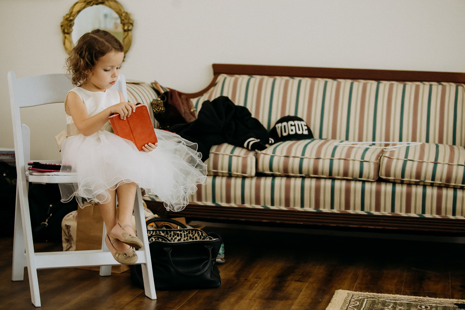 A flower girl playing with an ipad