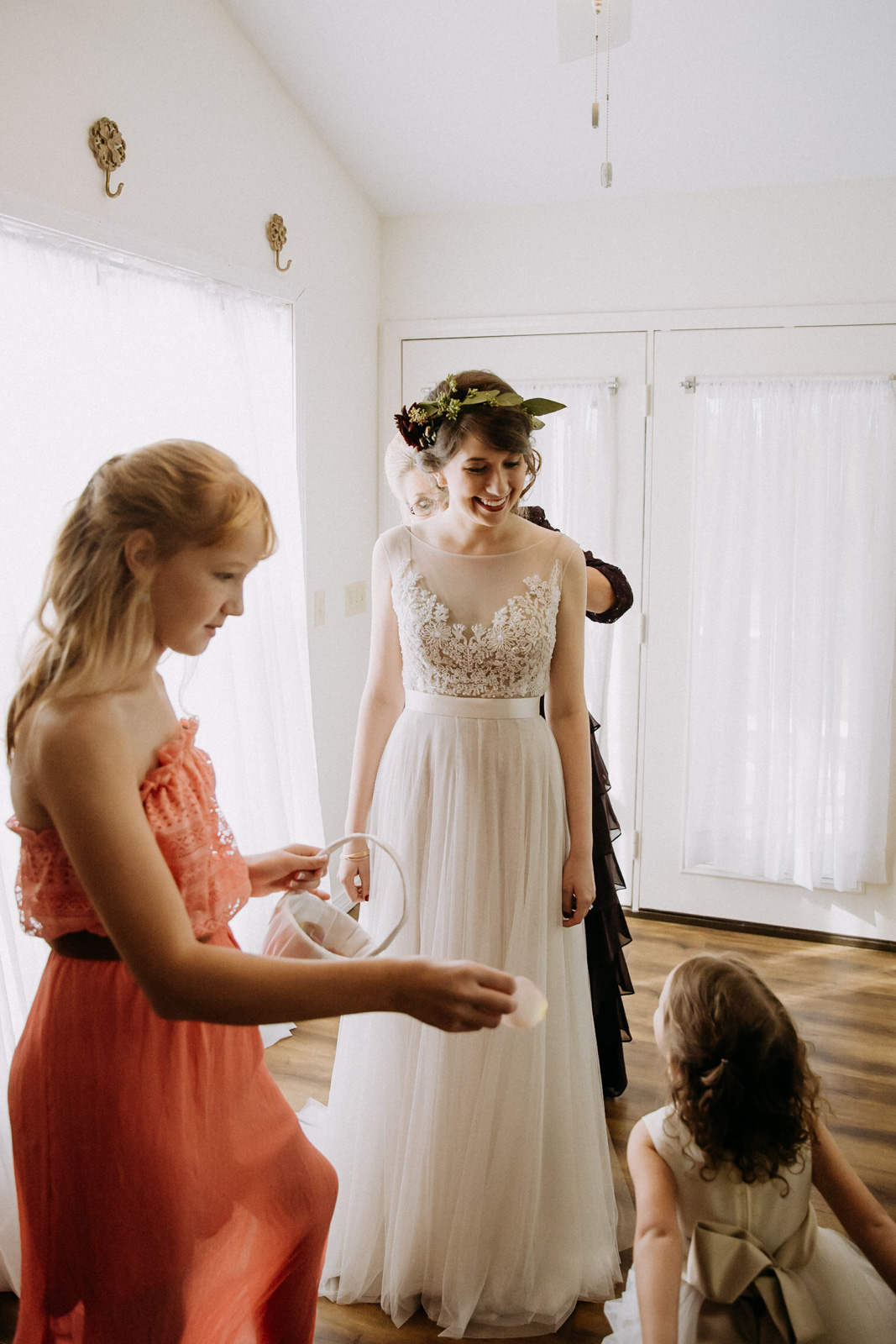Bride getting buttoned into her Watters dress