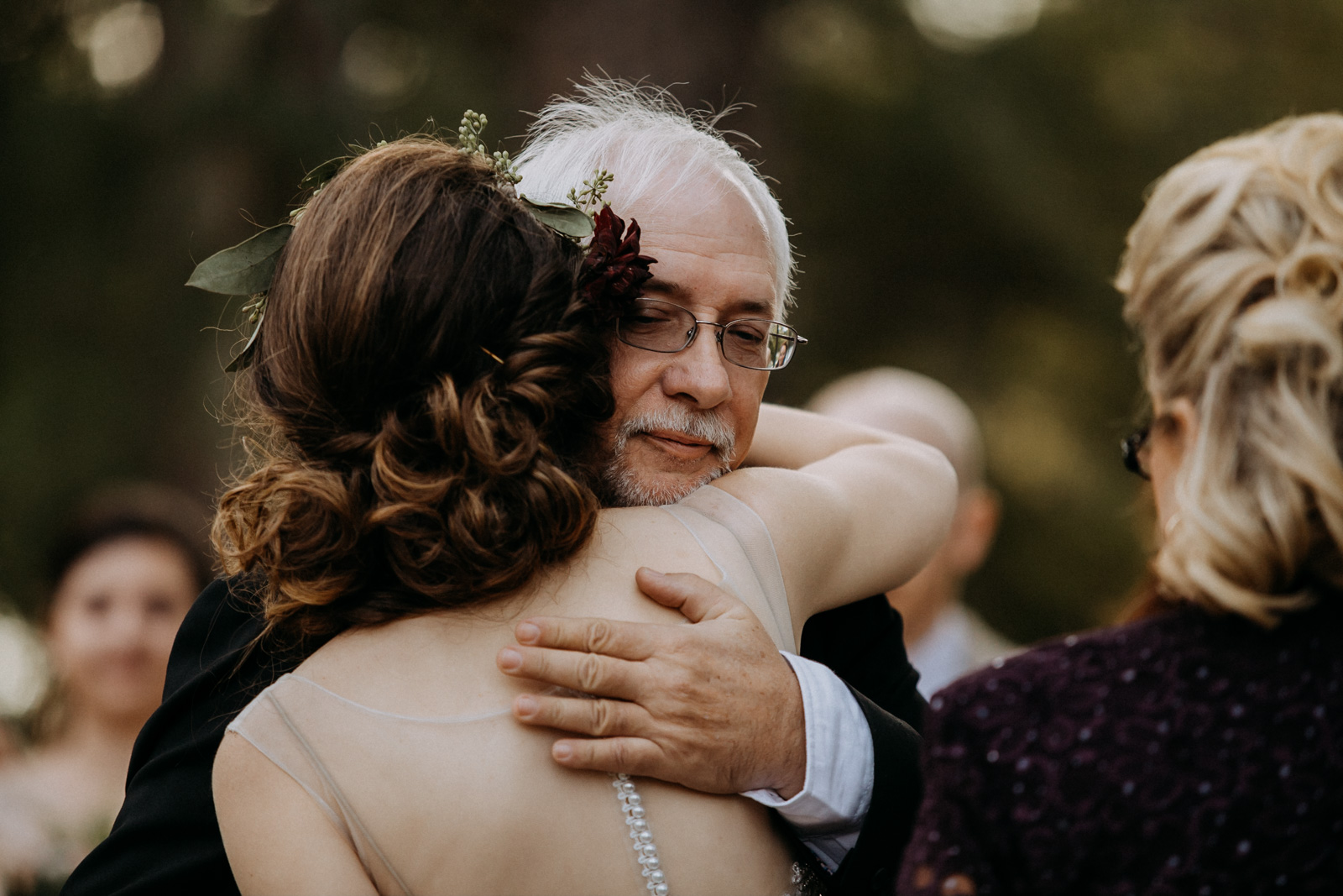 The bride hugging her father at the altar