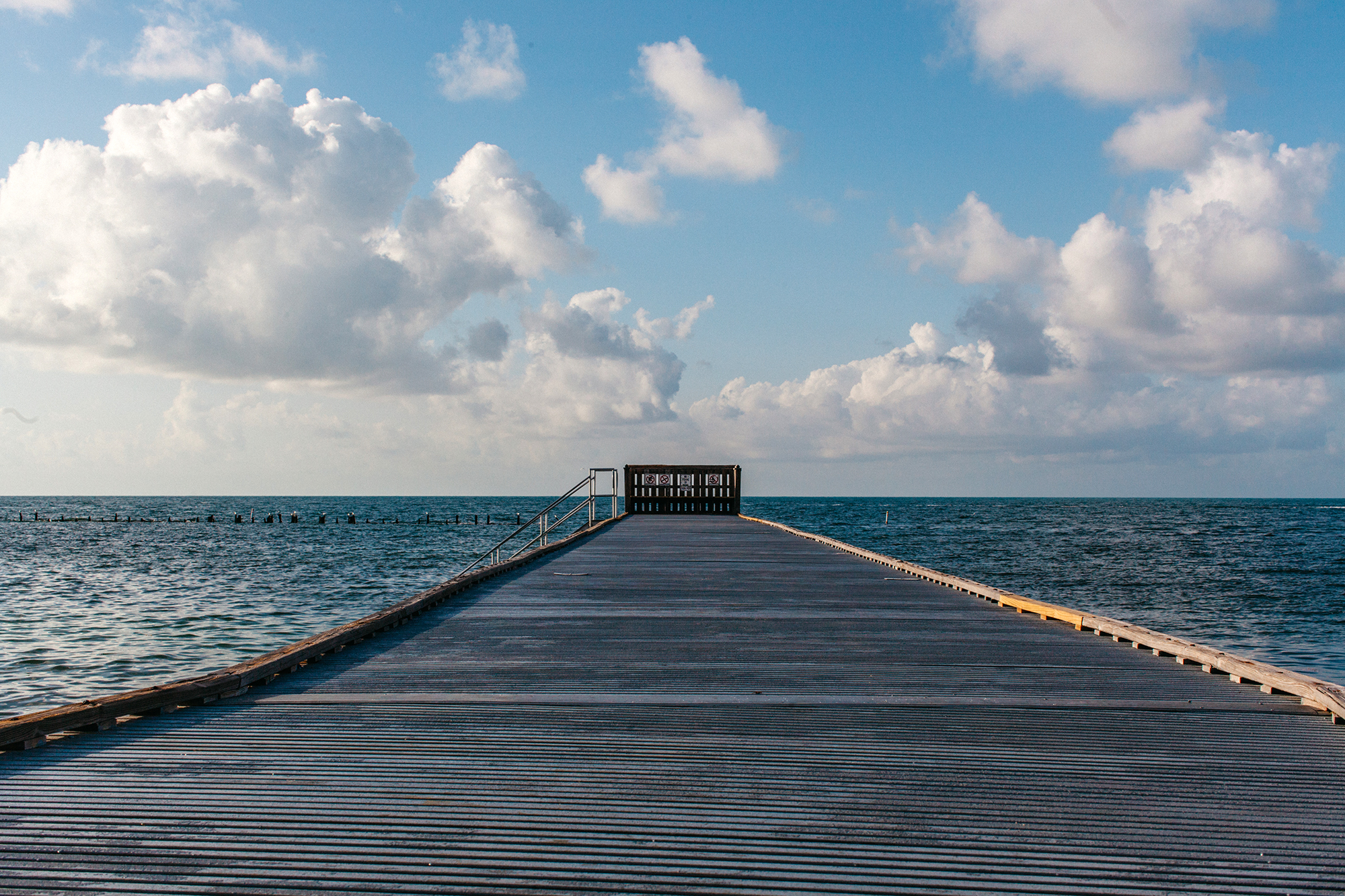 The walk way at Higgs Beach is where pedestrians can chill in the sun or climb down to swim.