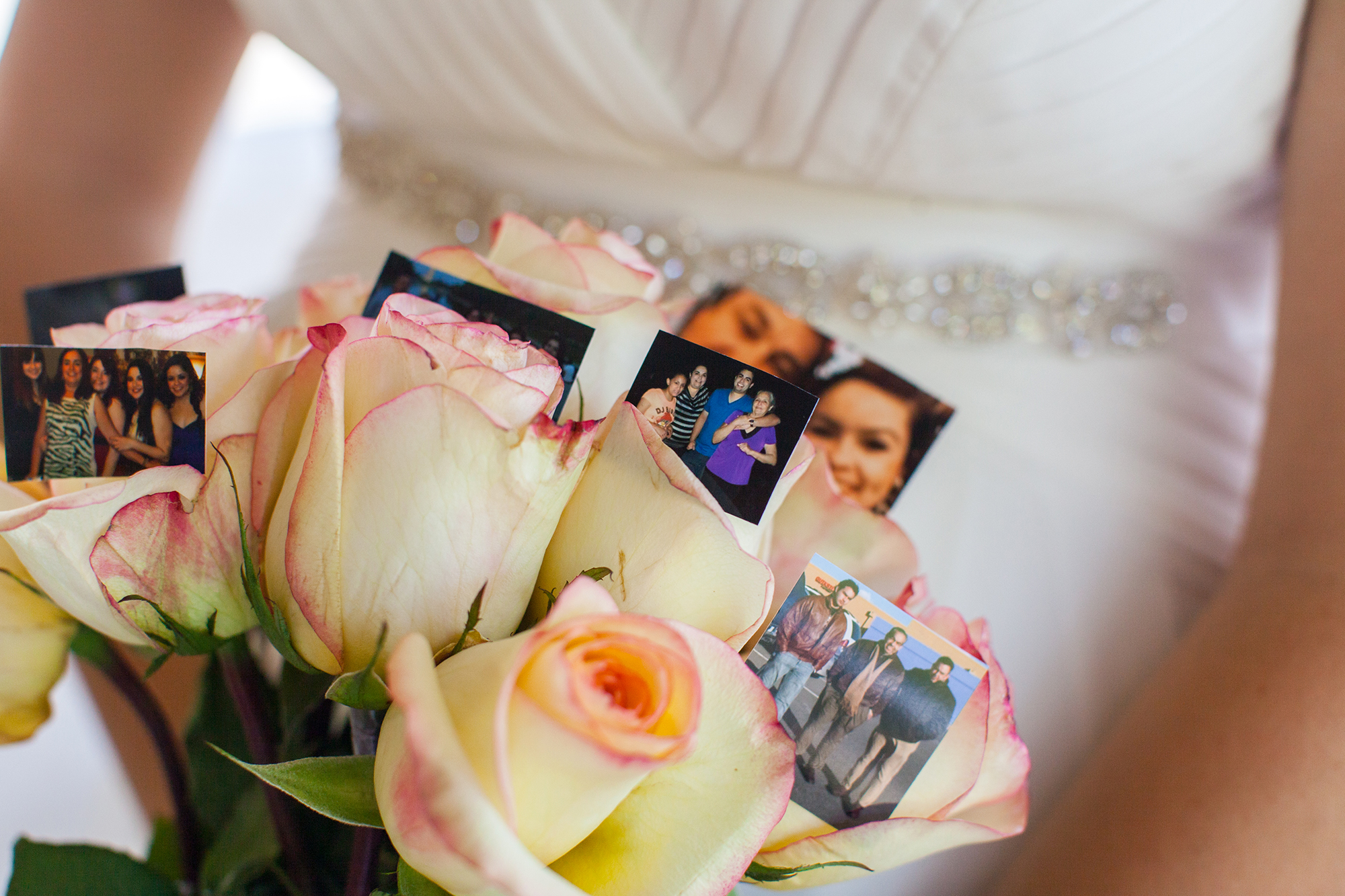 Despite the small party that attended, I thought it was sweet that Leslie had photos of her loved ones as part of her wedding bouquet.