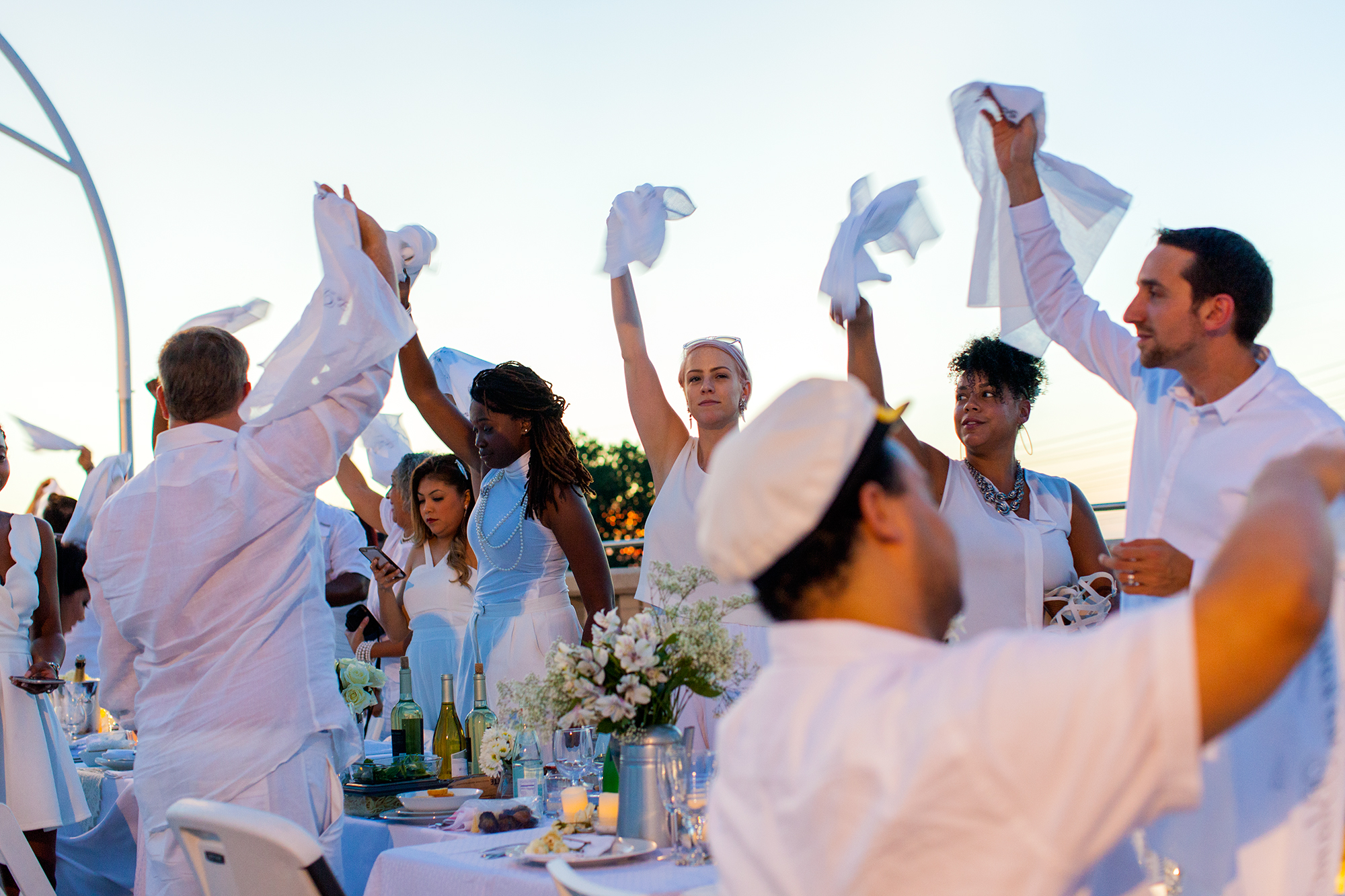 The napkin wave signals the official start of the Diner En Blanc