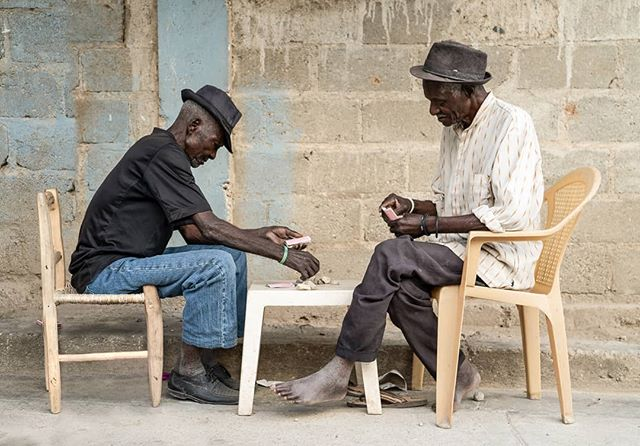 Two men playing cards in Haiti, betting with rocks . . #photo #photos #pic #pics #photography #instapic #picture #beautiful #instagood #picoftheday #photooftheday #all_shots #composition #focus #paintingwithlight #moodyports #photoart #photogenic #natgeo100contest #natgeoyourshot #natgeo #haiti #travelphotography #travel
