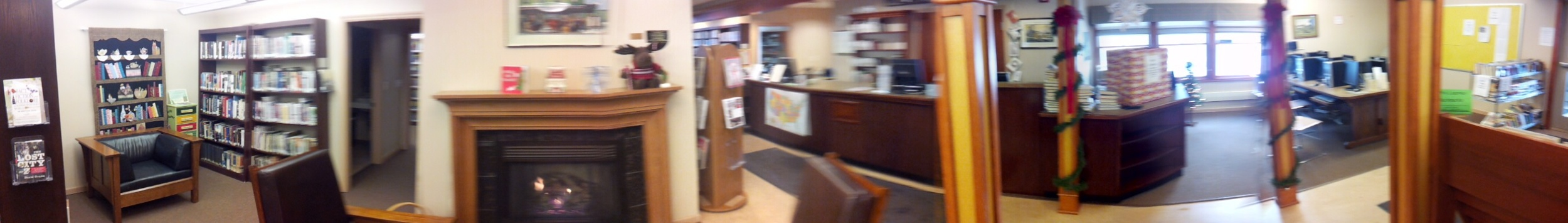 Pano of the interior front of our little library...