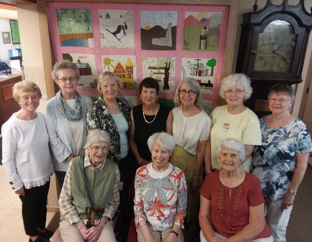 Some of the quilters welcoming the quilt back to the library on 6/9/19.