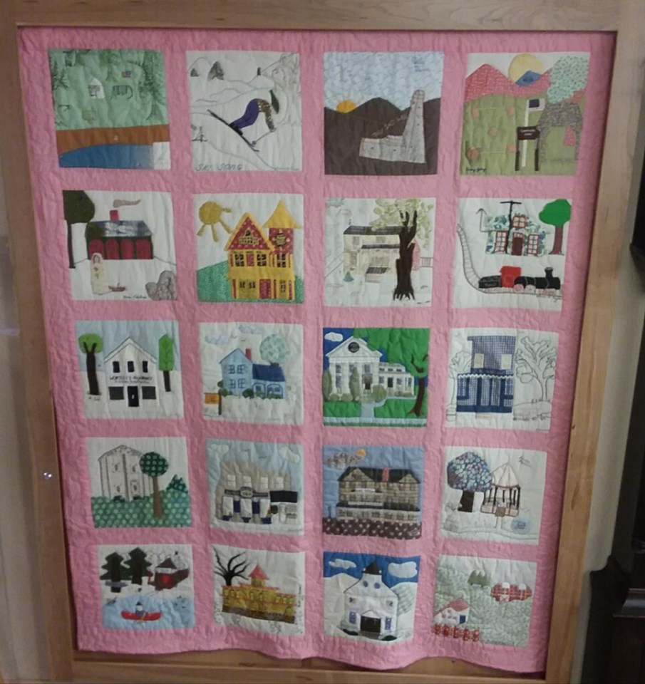 The quilt in the cherry frame built by Woodmansee Woodwrights.