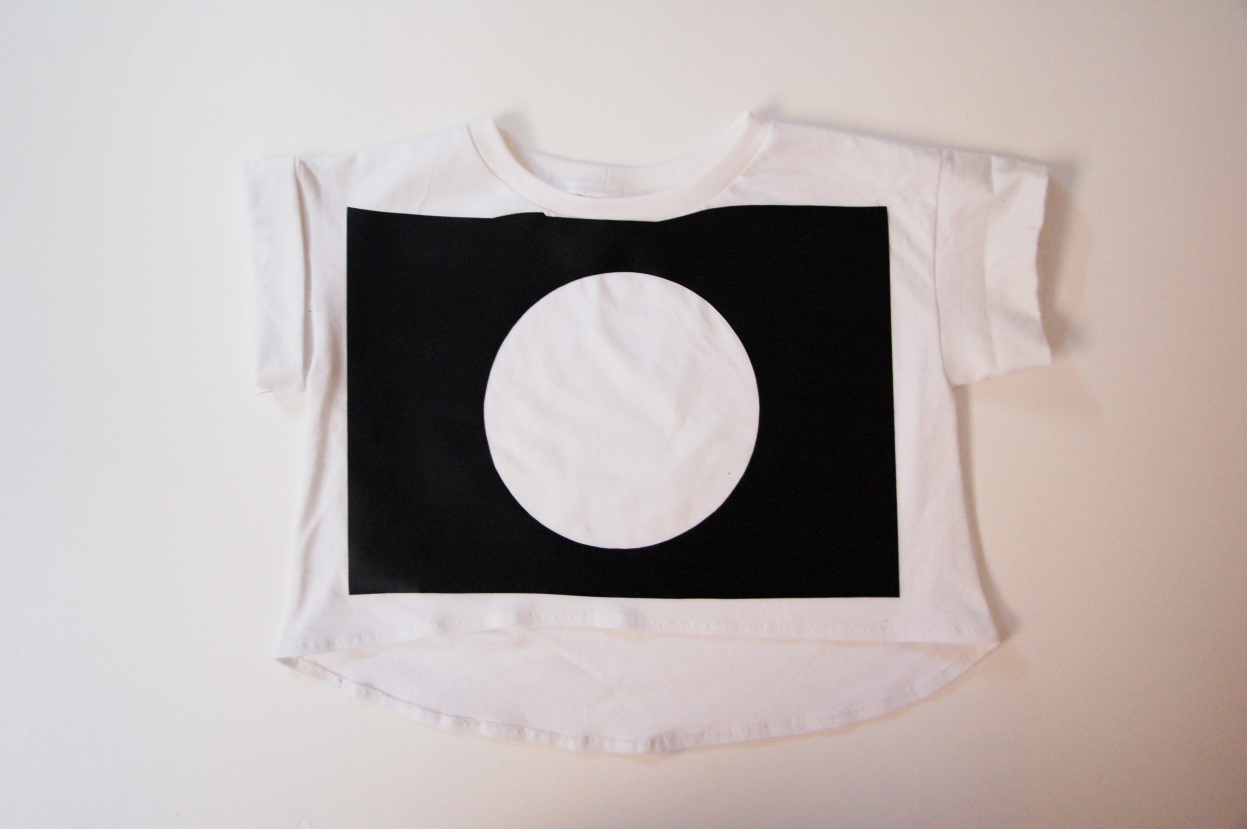 Apply the template to the t-shirt, by peeling of the backing and sticking if using vinyl or ironing if using freezer paper.