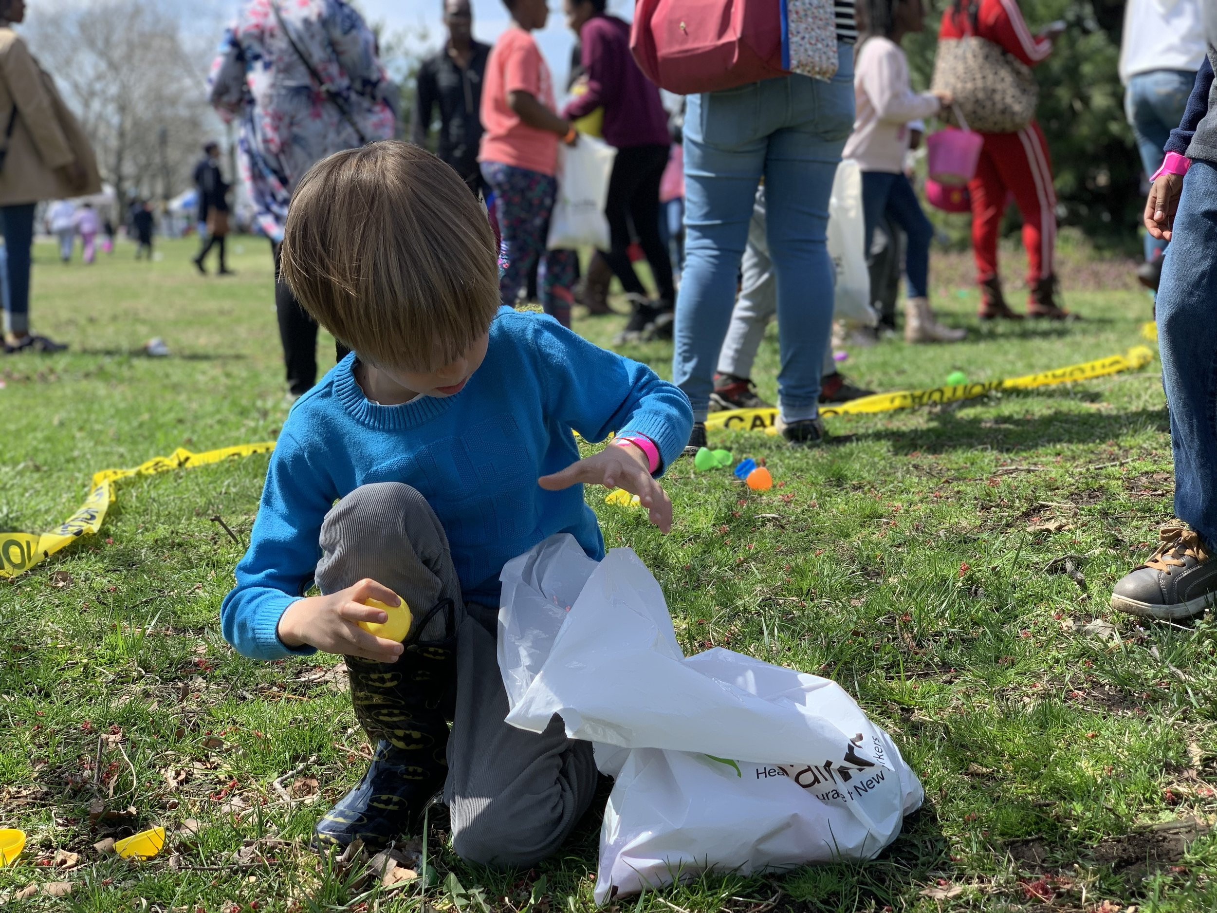 SD-Easter-Egg-Hunt_Sergio-getting-eggs_April-2019.jpg