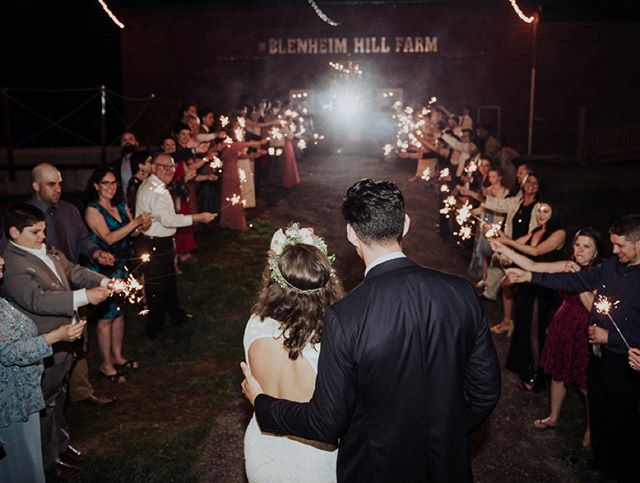 A magical sparkler sendoff in front of the red barn!