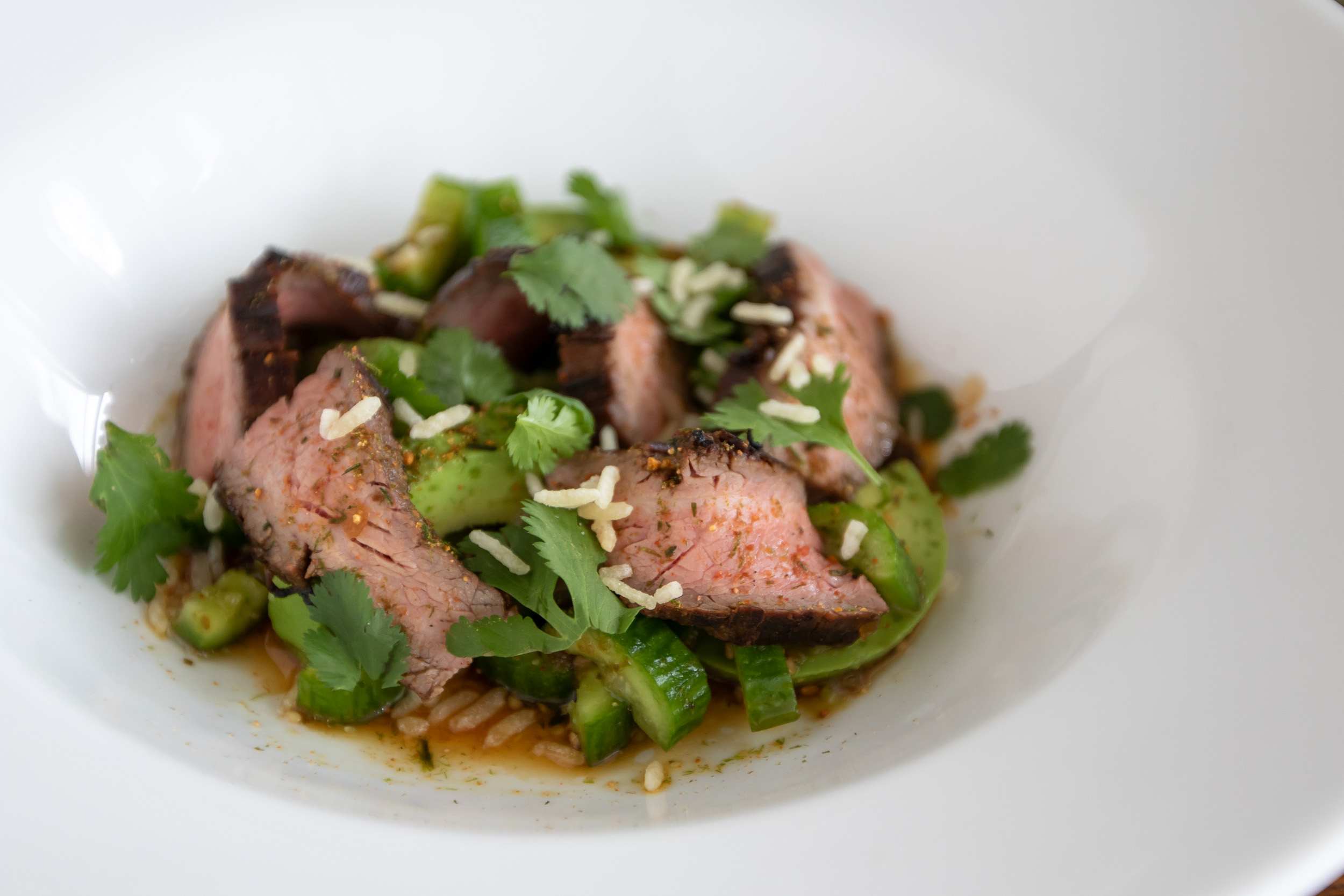 Soy Dressing on Grilled Flank Steak & Avocado Salad with Cucumbers and Puffed Jasmine Rice | Photo by  Stephanie Cornell