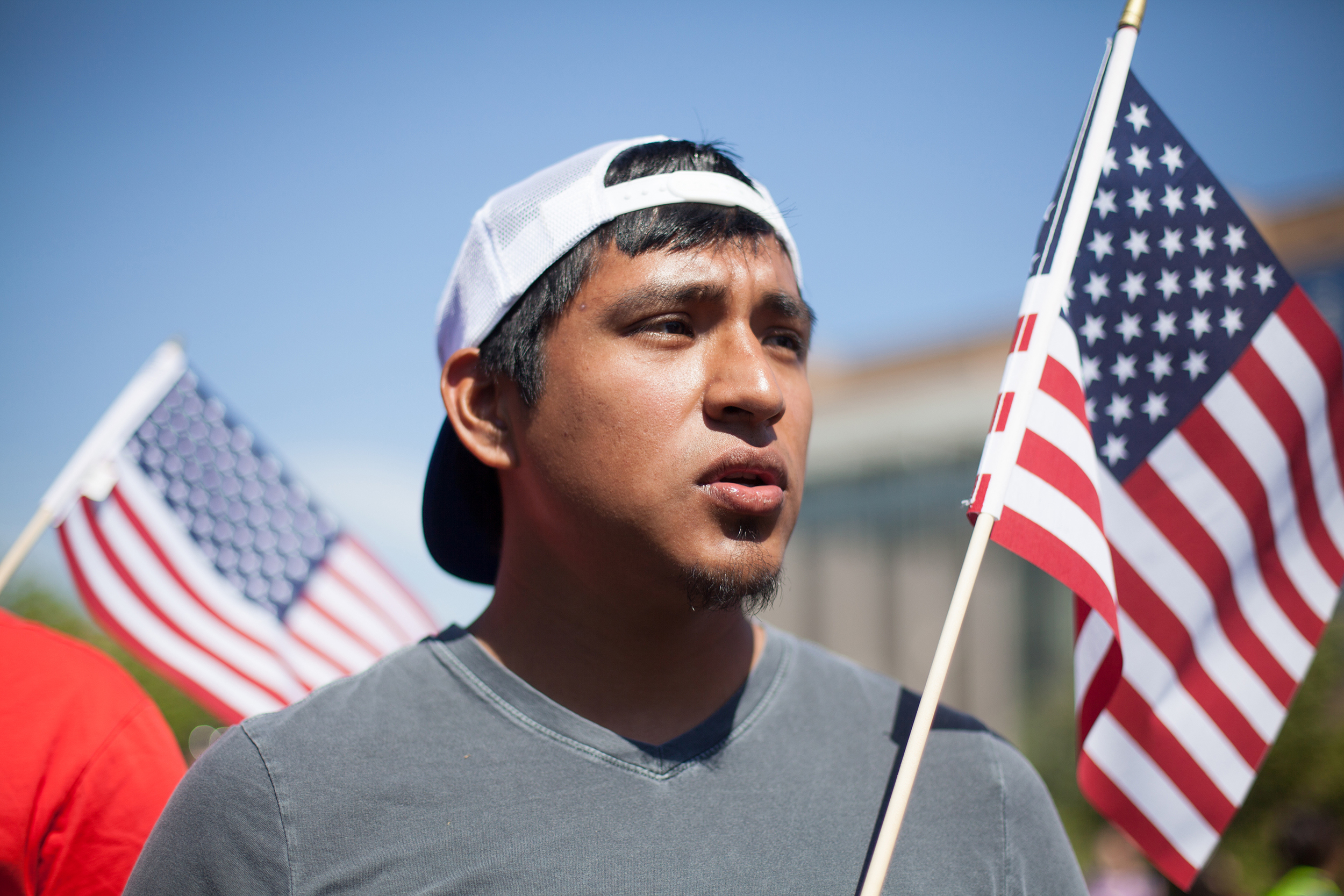 Texas A&M student, Issac Chavez protesting immigration reform during President Barack Obama's arrival to the Civil Rights Summit at the LBJ Presidential Library.