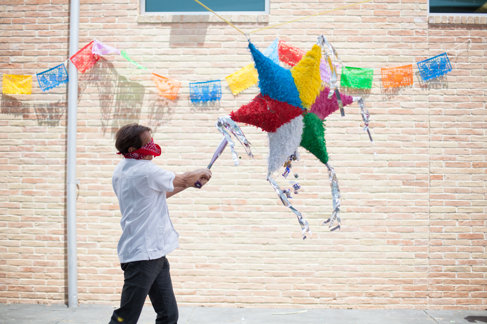 Dr. Juan Sanchez hitting the pinata during Southwest Key's Cinco de Mayo Celebration in May 2014.