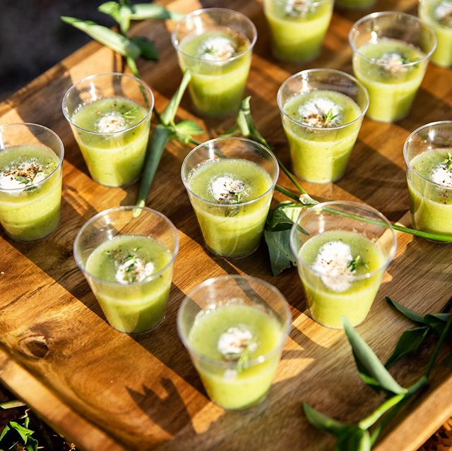 Chilled pea soup shooters with garlic cream and fresh herbs from the @pioneerworks garden #HarvestandRevel