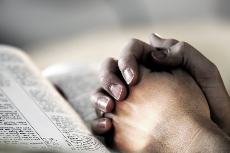 praying hands over scipture.jpg