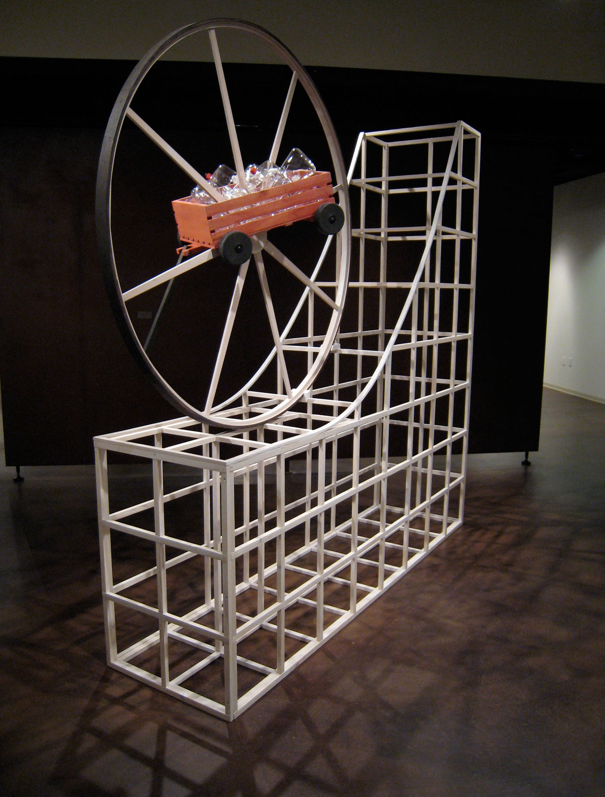 """""""Launch"""", wood sculpture 11' h x 2' w x 8' d ; stained and ebonized wood and glass beakers, © Tom Gormally"""