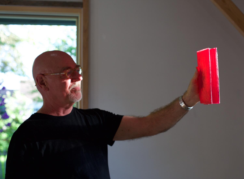 Tom inspecting cast resin book. Photo: Malayka Gormally