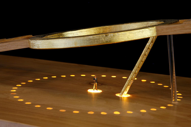 """The Golden Ladder"" (detail), 2017, 30"" h x 11"" w x 16"" d; wood, gold leaf, paint, plexi rod, LED lights, plastic figure, steel; © Tom Gormally"