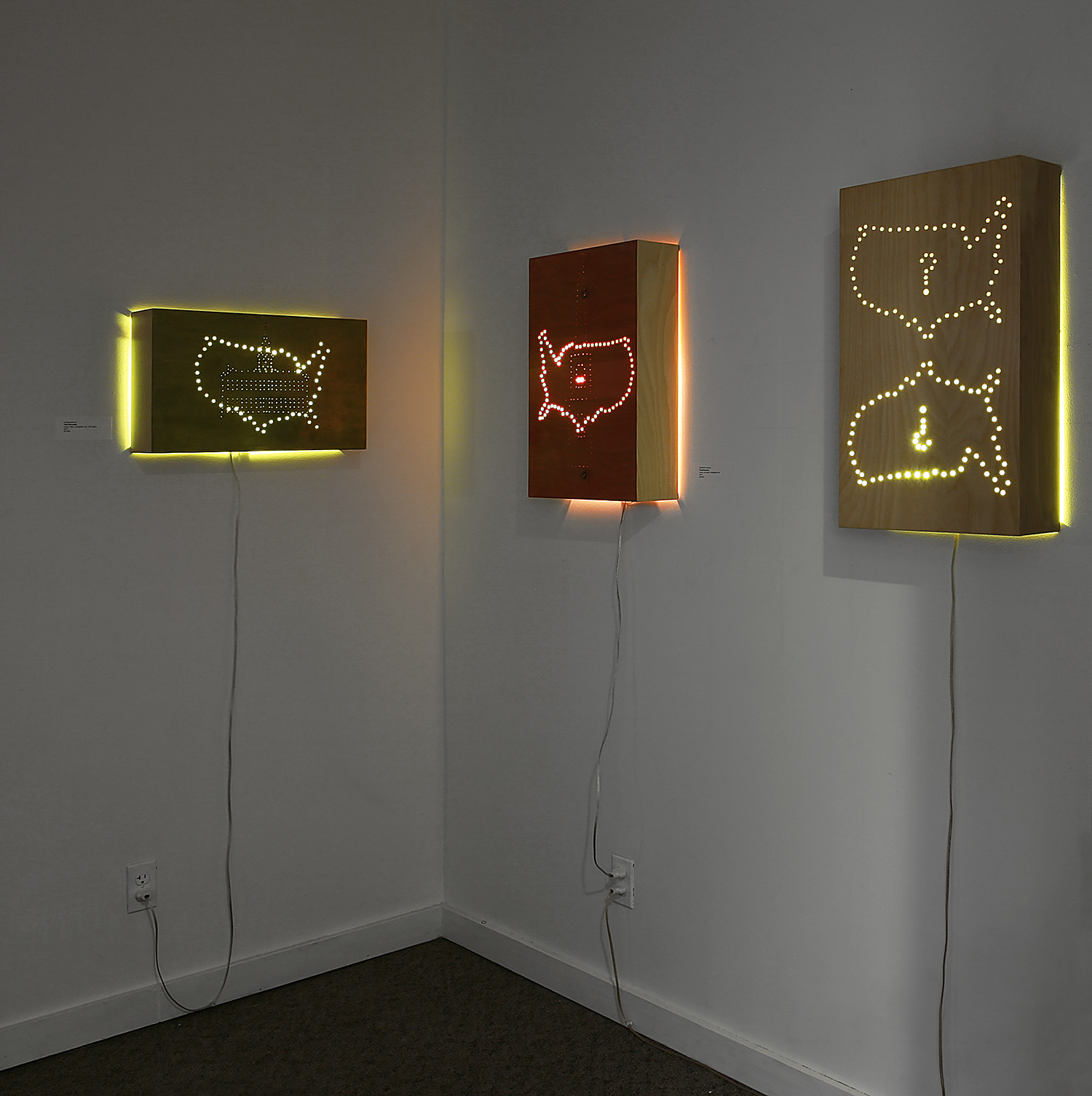 """Patriot Series"" installation, dimensions variable; wood, gold leaf, wood dye, plexi rod, LED lights; © Tom Gormally 2017"
