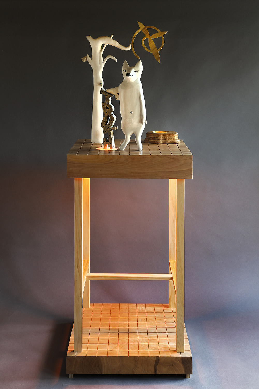 """Fox Leaning on the Truth"", 70"" h x 24"" w x 20"" d; wood, plexiglass, gold leaf, acrylic paint LED lights; © Tom Gormally 2019"