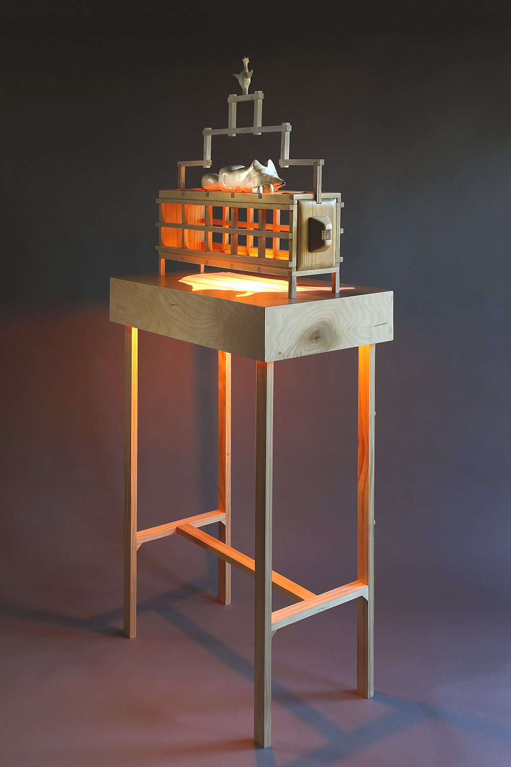 """Fox Trap"", 65"" h x 28"" w x 16"" d; wood, stain, plexiglass, acrylic paint, LED light; © Tom Gormally 2018"