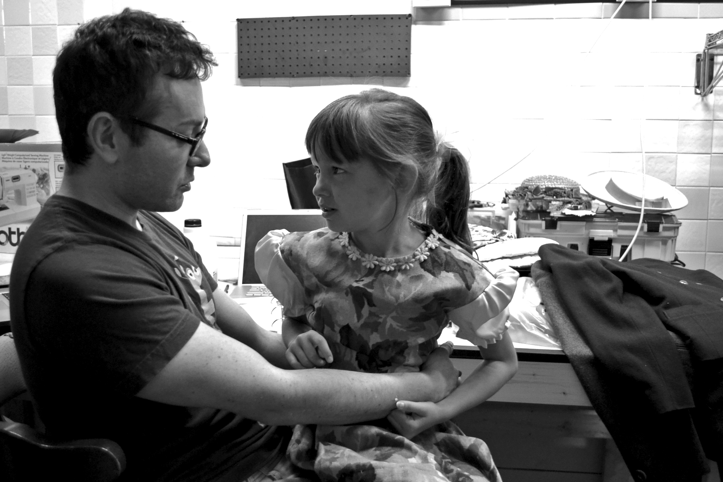 Director Joel Froomkin confers with Gabriella Betterly (Gretl von Trapp) during costume fittings.