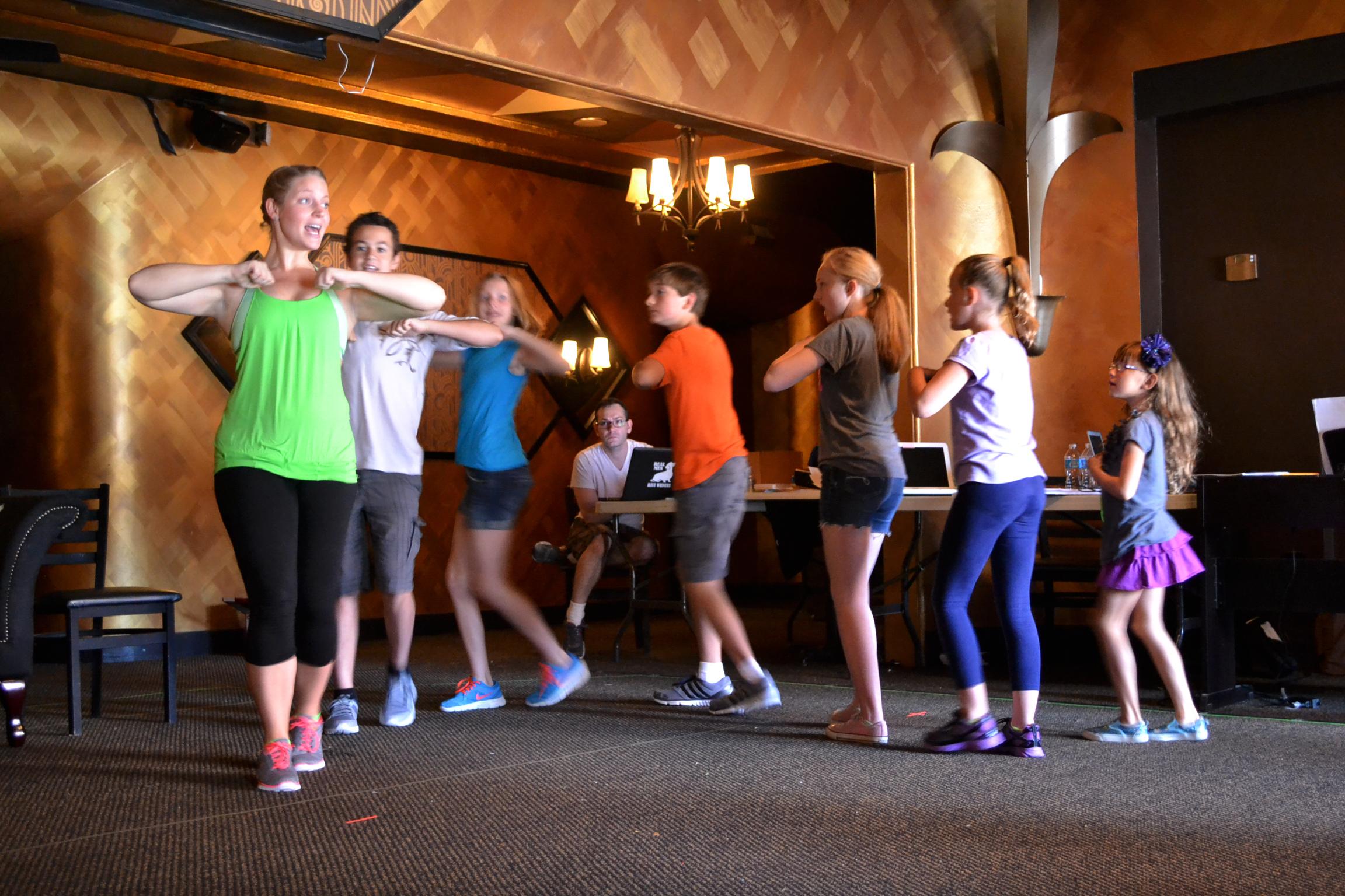 Choreographer Erin Baltsar works with the von Trapp Children.