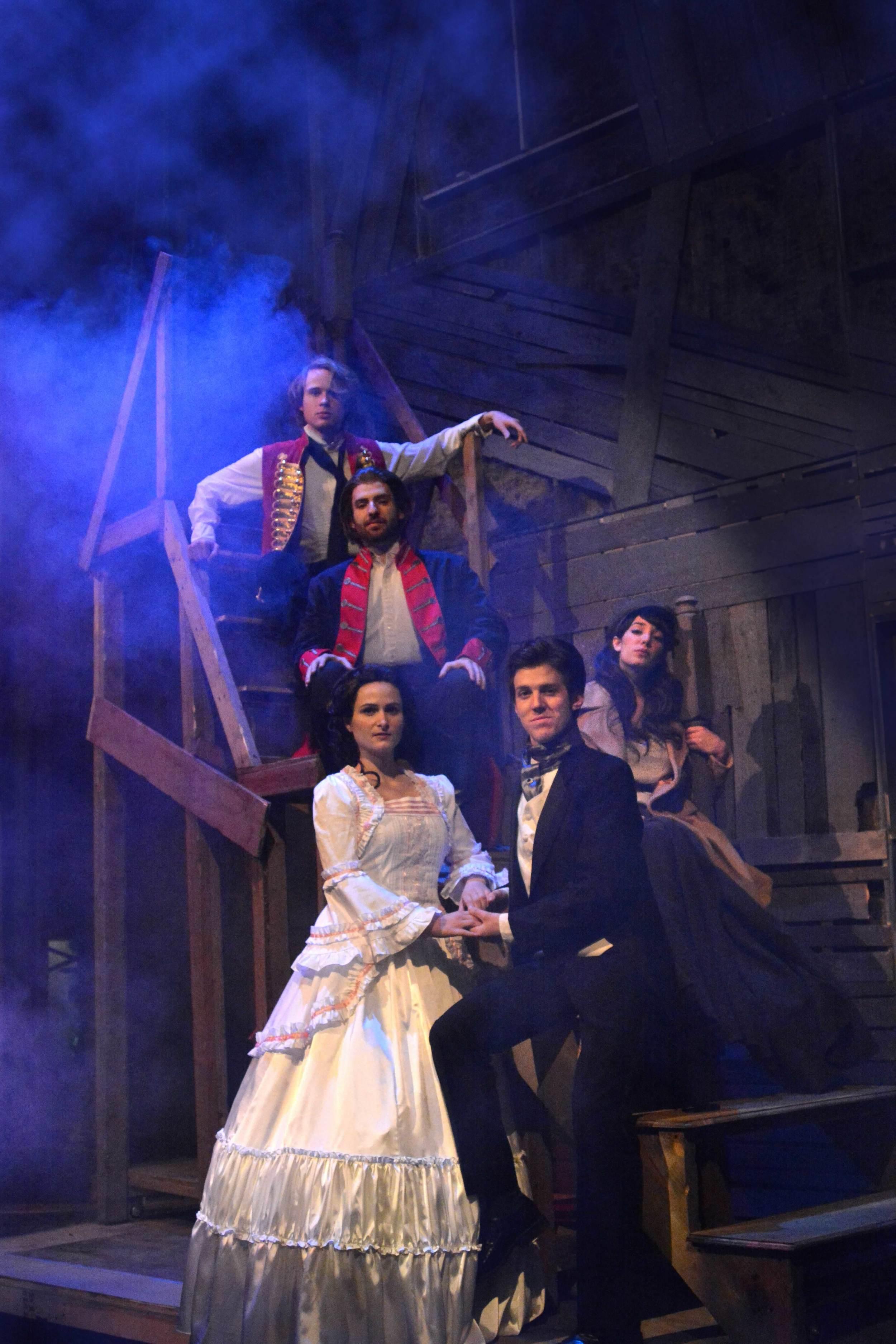 Charlie Tingen as Enjolras (red vest), Landon Sholar as Jean Valjean (blue and red jacket), Becky Rosky as Cosette (white dress), Ethan Carpenter as Marius (tux), Brooke Quintana as Eponine (camel coat)