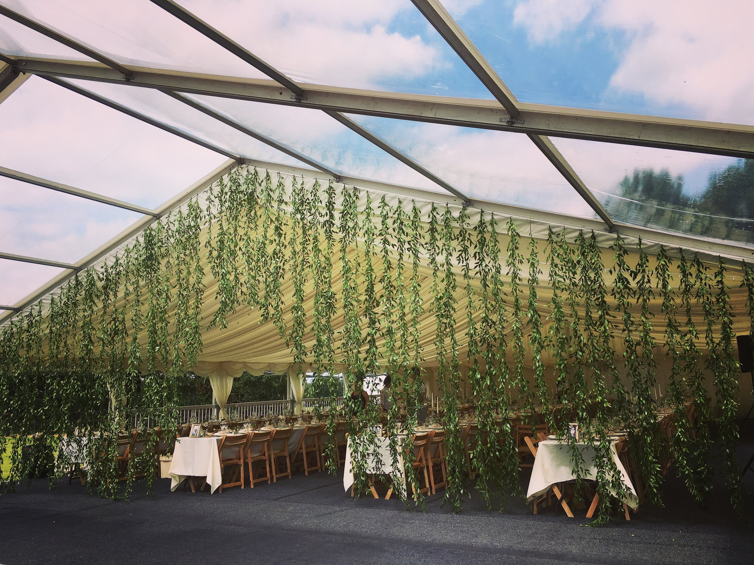 The all foliage curtain creating an effective divide between eating and dancing but also being a real talking point for your guests