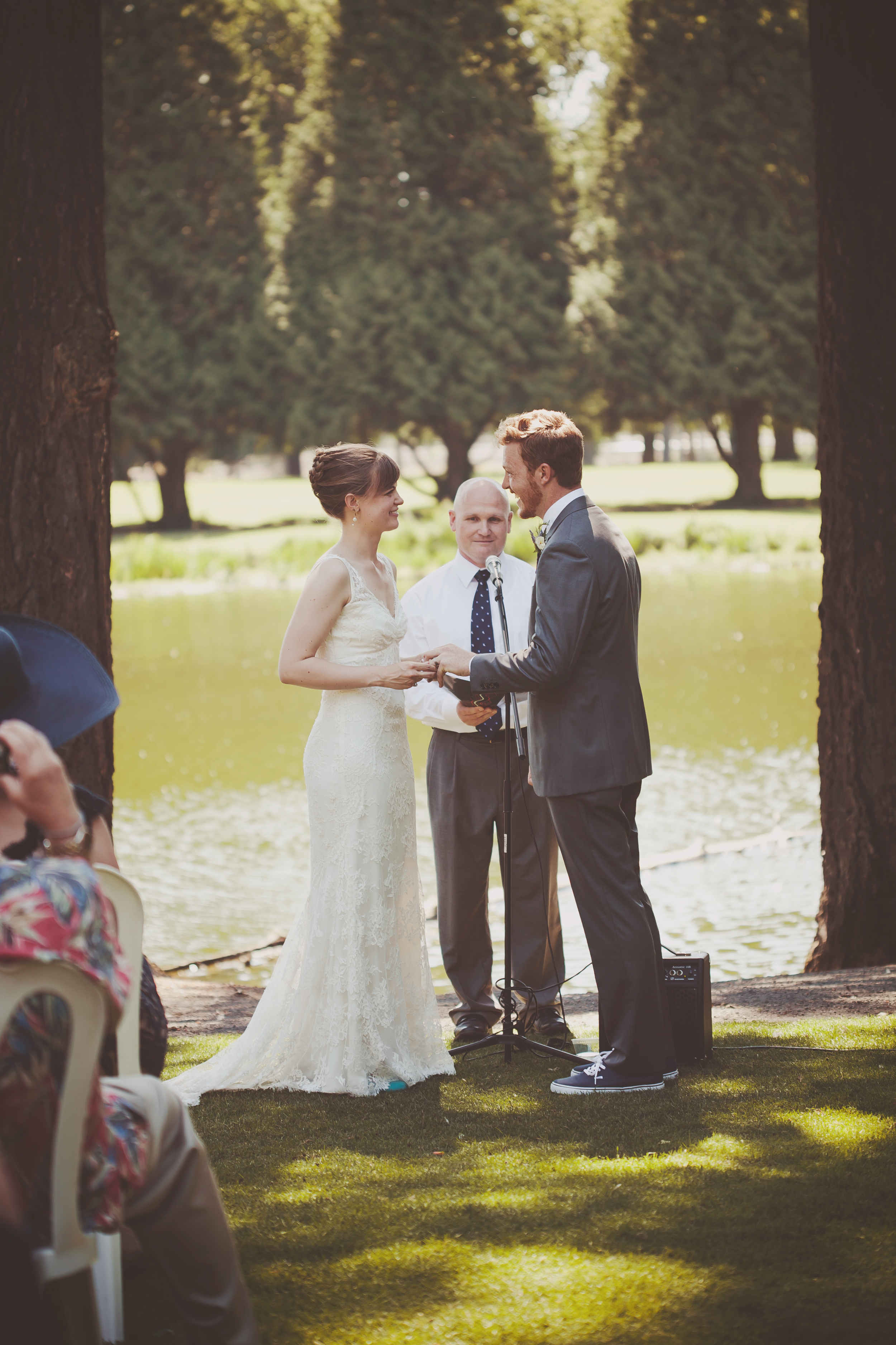 The gorgeous lakeside ceremony. We are loving the pop of color of Claire's shoes, which coordinates perfectly with the ribbon on her bouquet!